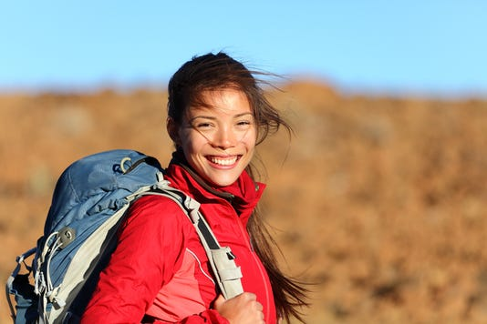 Young Woman With A Backpack Smiling At Camera