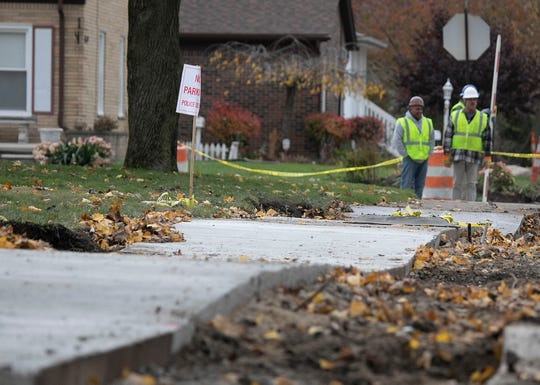 New sidewalks being installed on Firestone street in Dearborn are matching the contour of the wavy ground. Photographed on Thursday, Nov. 8, 2018.