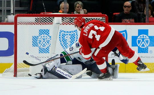 Red Wings center Dylan Larkin (71) recorded the first shootout goal of his professional career in Tuesday's win over the Canucks.