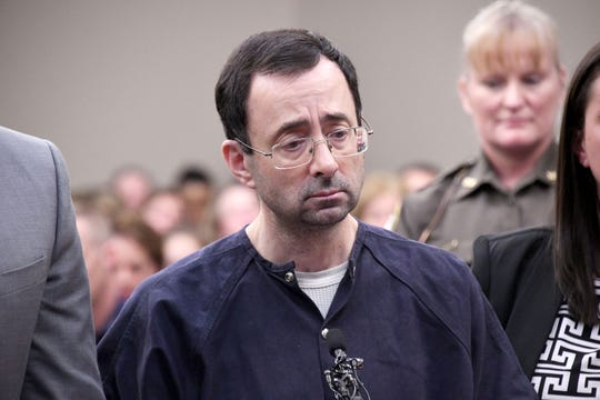 Larry Nassar is sentenced while flanked by attorneys Matthew Newburg and Molly Blythe in Eaton County Circuit Court  Aquilina on January 24, 2018.