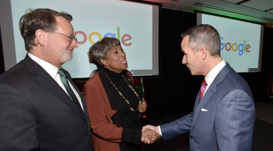 From right, llitch Holdings President and CEO Chris Ilitch talks with U.S. Rep Brenda Lawrence, and U.S. Sen. Gary Peters, before the program.
