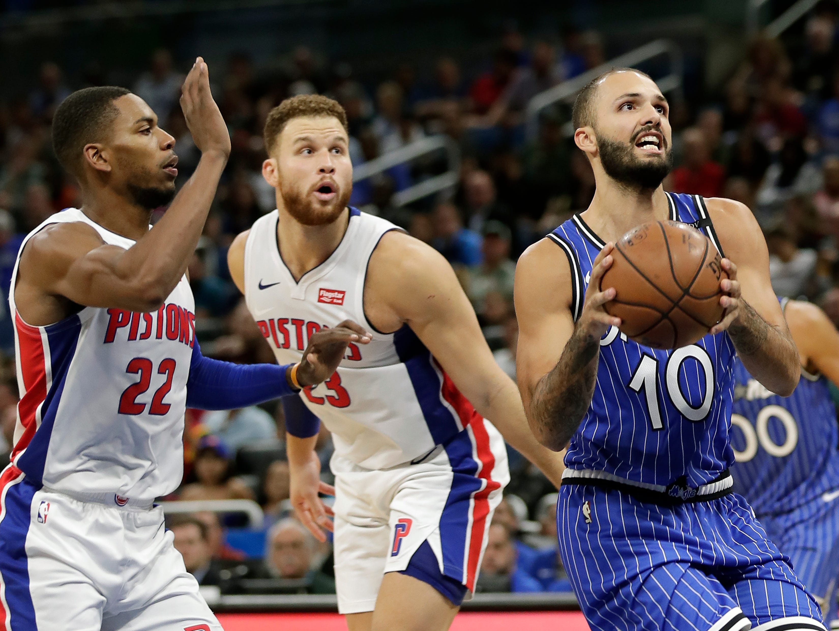Orlando Magic's Evan Fournier (10) looks for a shot as he gets past Detroit Pistons' Glenn Robinson III (22) and Blake Griffin (23) during the first half of an NBA basketball game, Wednesday, Nov. 7, 2018, in Orlando, Fla.