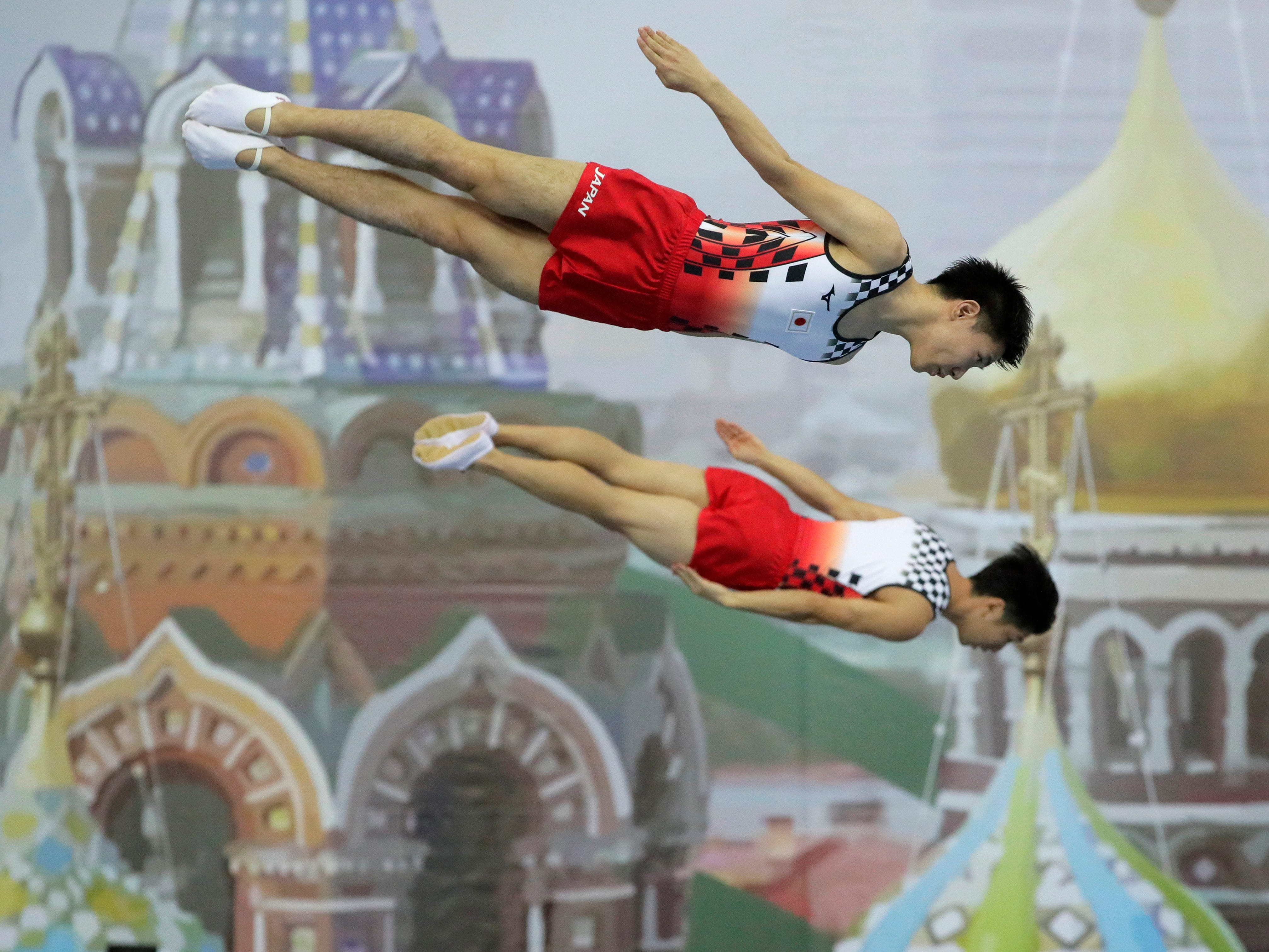 Yasuhiro Ueyama and Ryosuke Sakai of Japan perform during the men's synchronized qualifications of the 33rd Trampoline Gymnastics World Championships in St. Petersburg, Russia, Thursday, Nov. 8, 2018.