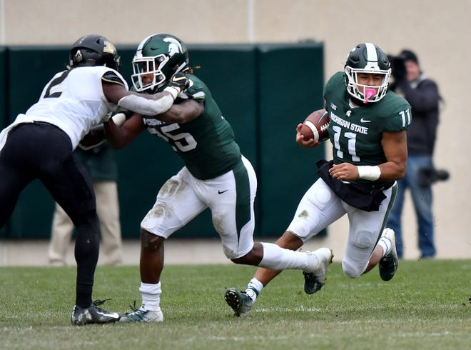 Running back Connor Heyward (11) accounted for 157 of Michigan State's 269 yards rushing last weekend at Maryland.