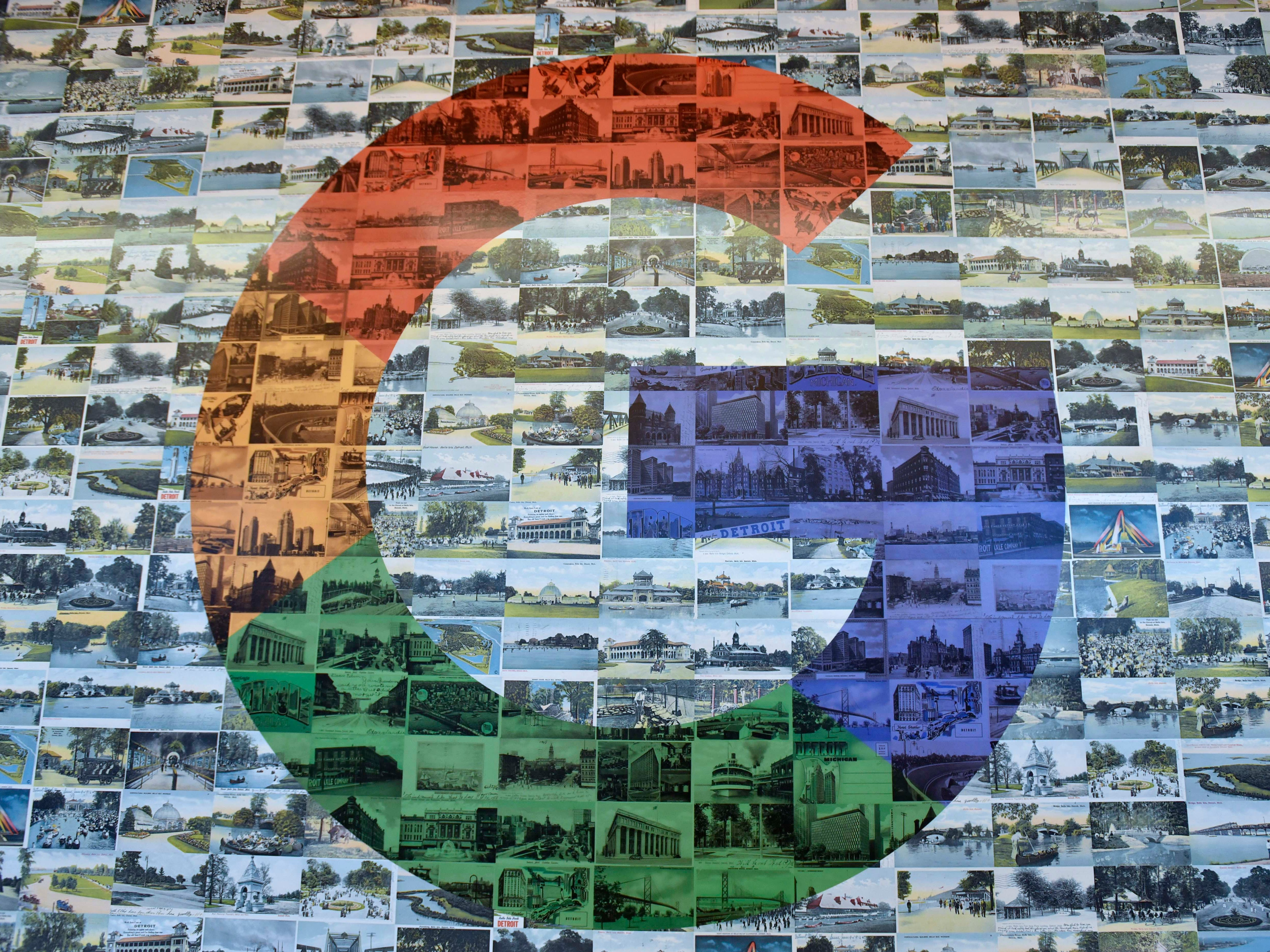 This is Google's icon, made from old Detroit post cards, on the wall in the Belle Isle room.