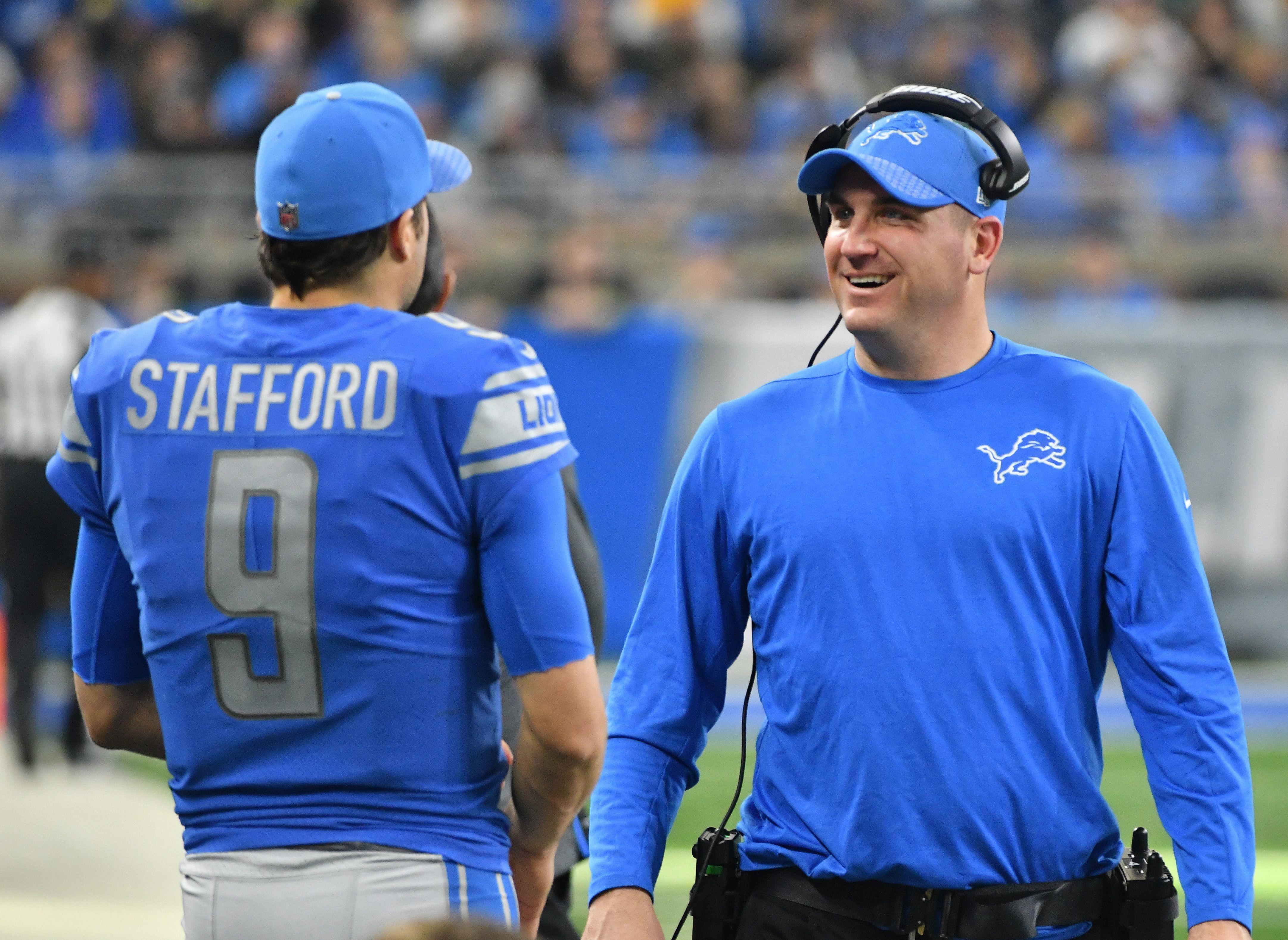 Offensive coordinator Jim Bob Cooter, right, and quarterback Matthew Stafford