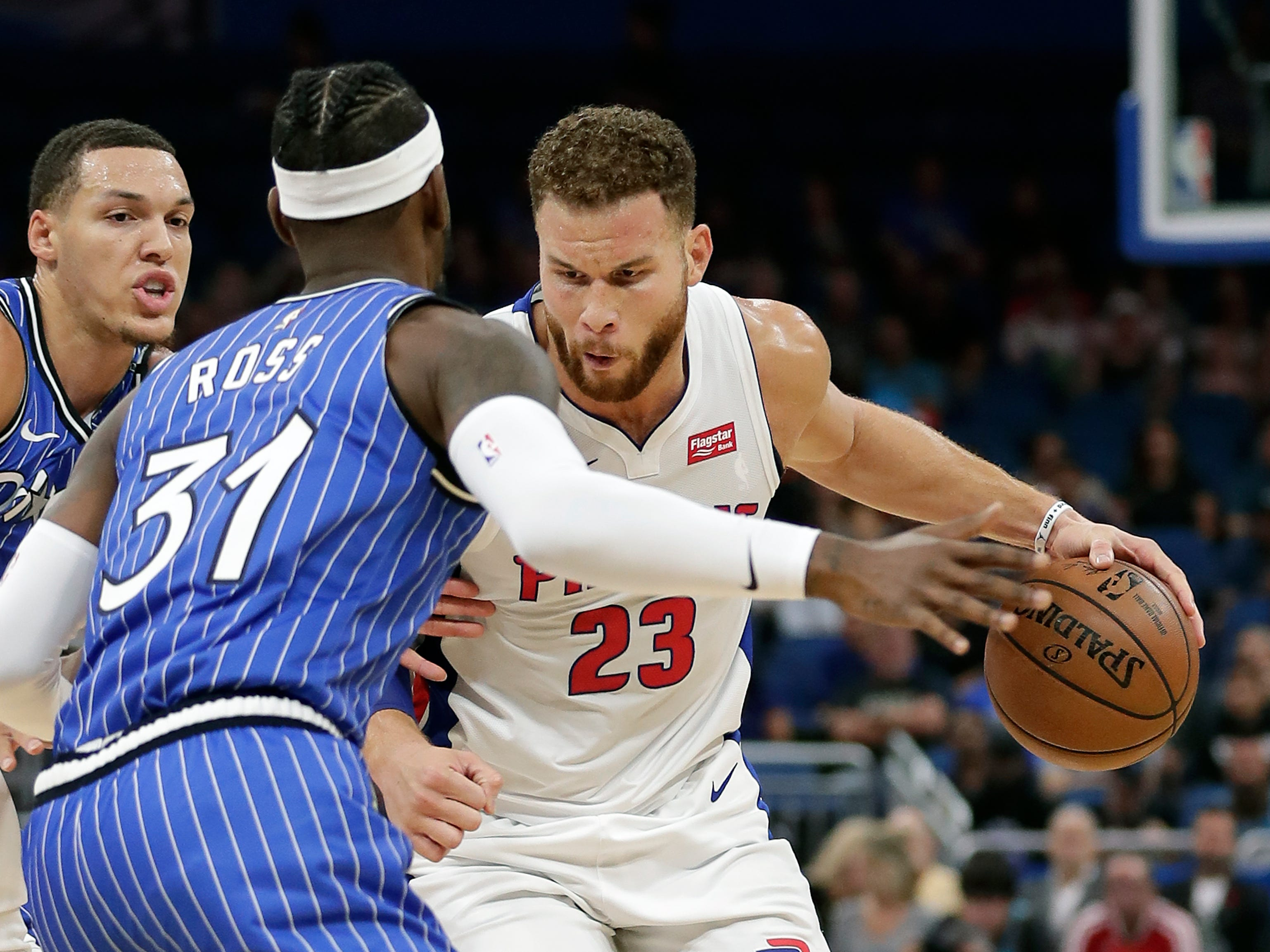 Detroit Pistons' Blake Griffin (23) looks for a way around Orlando Magic's Aaron Gordon, left, and Terrence Ross (31) during the first half of an NBA basketball game, Wednesday, Nov. 7, 2018, in Orlando, Fla.