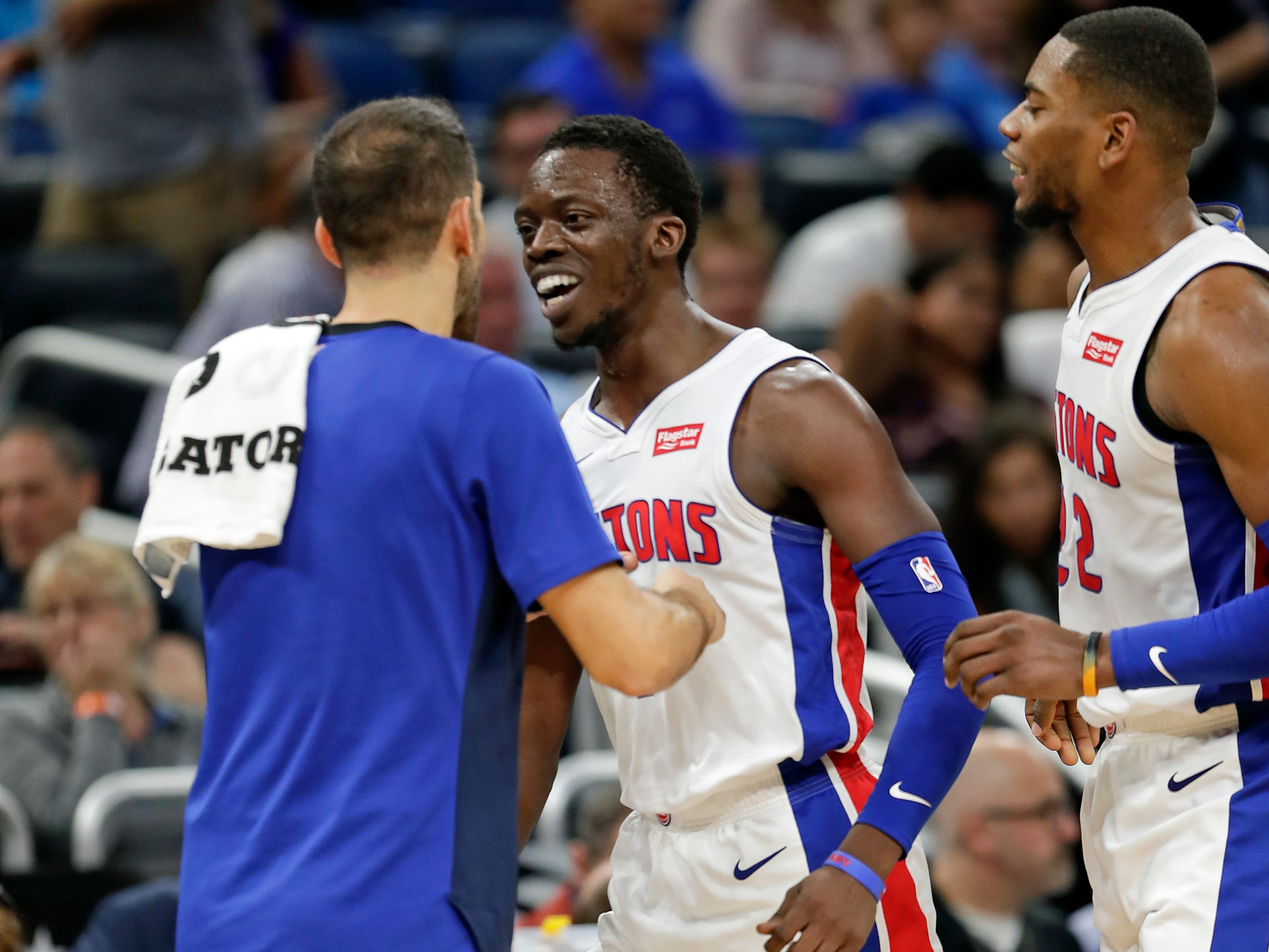 Detroit Pistons' Reggie Jackson, center, celebrates a 3-point shot during a time out with teammates Jose Calderon, left, and Glenn Robinson III, right, in the second half.