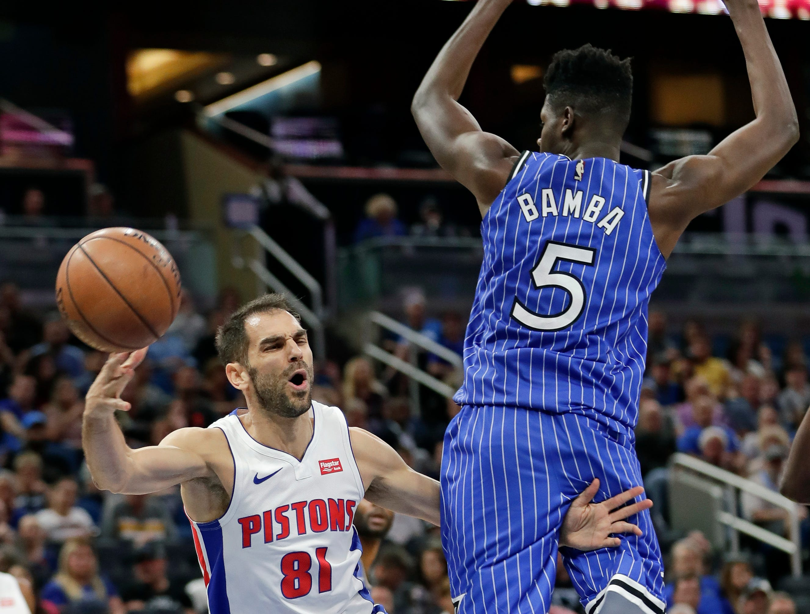 Detroit Pistons' Jose Calderon (81) passes the ball around Orlando Magic's Mohamed Bamba (5) during the first half of an NBA basketball game, Wednesday, Nov. 7, 2018, in Orlando, Fla.
