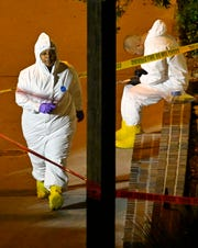 """A forensics team works the scene Thursday in Thousand Oaks, Calif. where a gunman opened fire Wednesday inside a country dance bar crowded with hundreds of people on """"college night."""""""