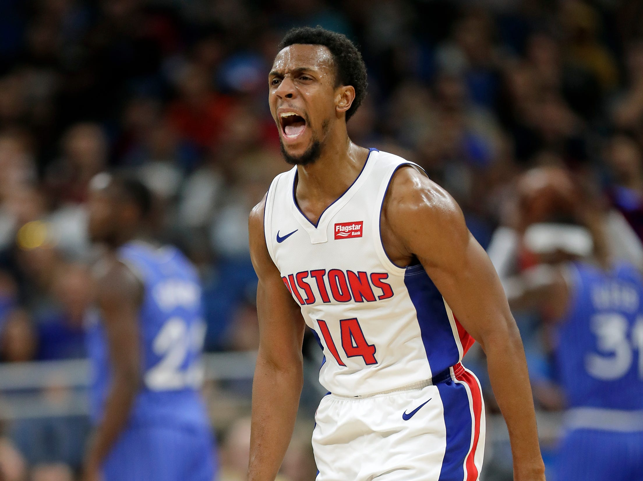 Detroit Pistons' Ish Smith celebrates after a teammate made a 3-point shot against the Orlando Magic during the second half of an NBA basketball game, Wednesday, Nov. 7, 2018, in Orlando, Fla.