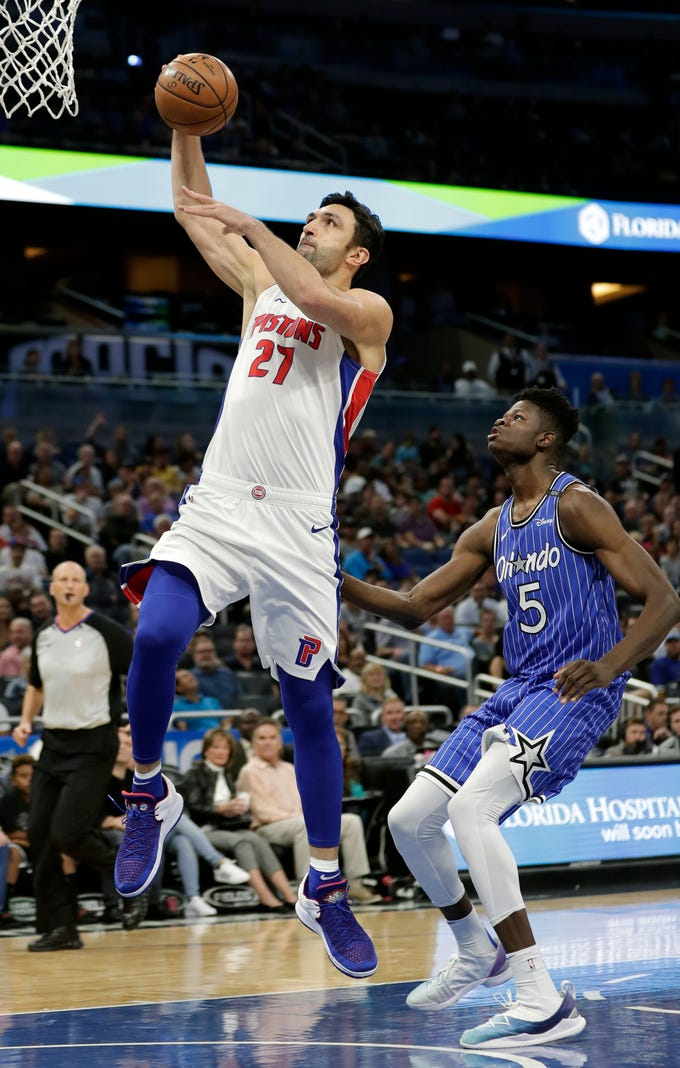 Detroit Pistons' Zaza Pachulia (27) goes past Orlando Magic's Mohamed Bamba (5) for a shot during the first half of an NBA basketball game, Wednesday, Nov. 7, 2018, in Orlando, Fla.
