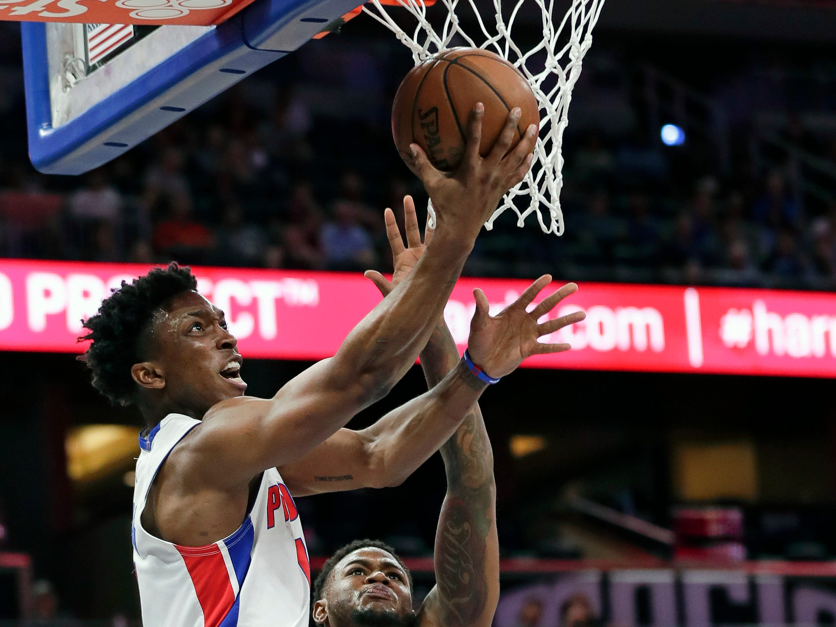 Detroit Pistons' Stanley Johnson, left, goes up for a shot past Orlando Magic's Jarell Martin (2) during the first half of an NBA basketball game, Wednesday, Nov. 7, 2018, in Orlando, Fla.