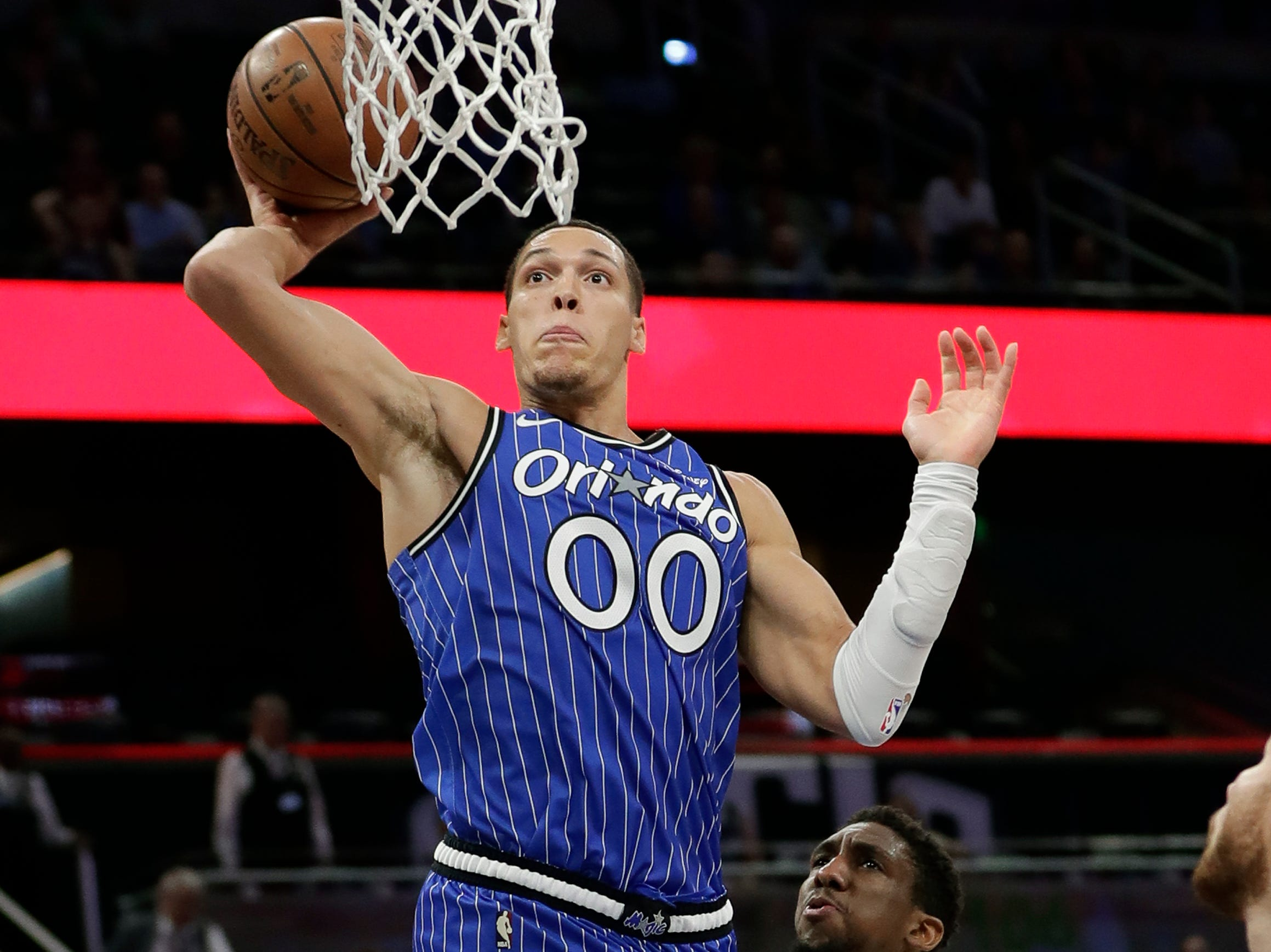 Orlando Magic's Aaron Gordon (00) goes up to dunk over Detroit Pistons' Langston Galloway, right, during the second half of an NBA basketball game, Wednesday, Nov. 7, 2018, in Orlando, Fla.