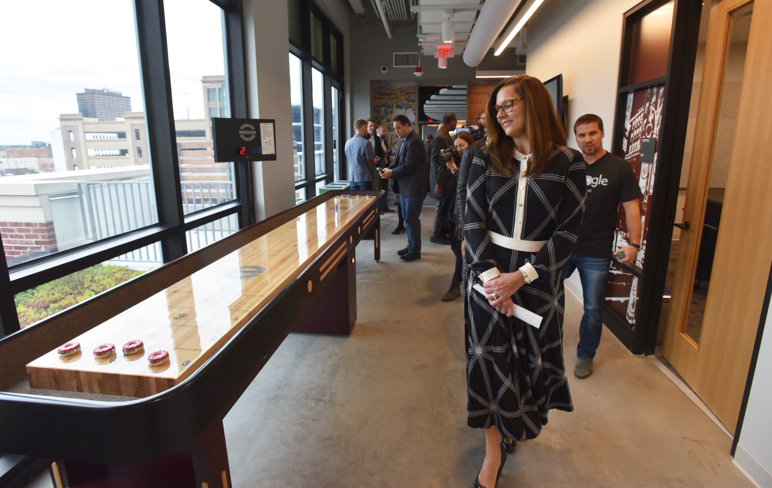 Google Detroit Site Lead Danielle Russell walks past a shuffle board table during a media tour of the facility in Little Caesars Arena.