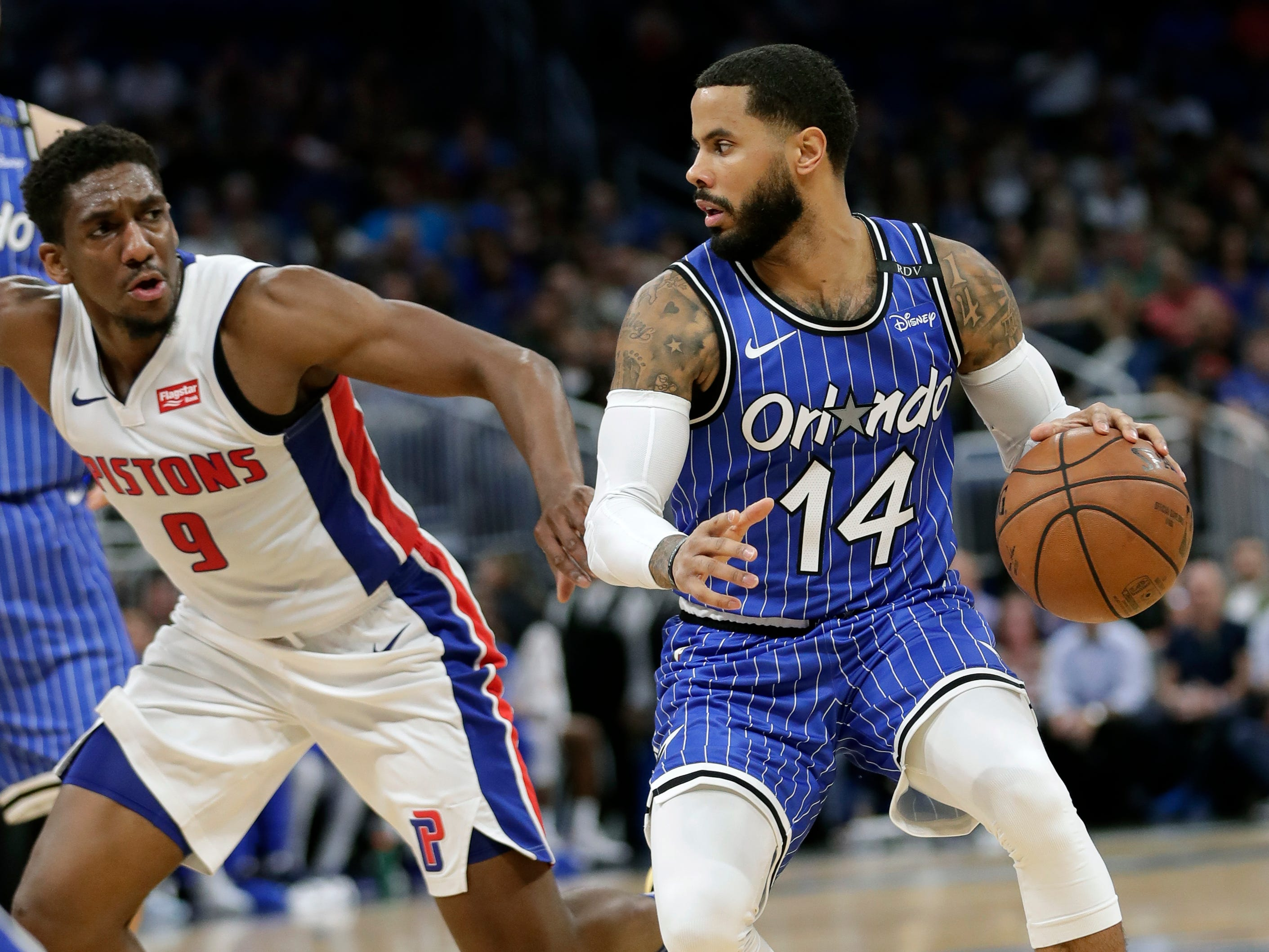 Orlando Magic's D.J. Augustin (14) looks for a way past Detroit Pistons' Langston Galloway (9) during the second half of an NBA basketball game, Wednesday, Nov. 7, 2018, in Orlando, Fla.