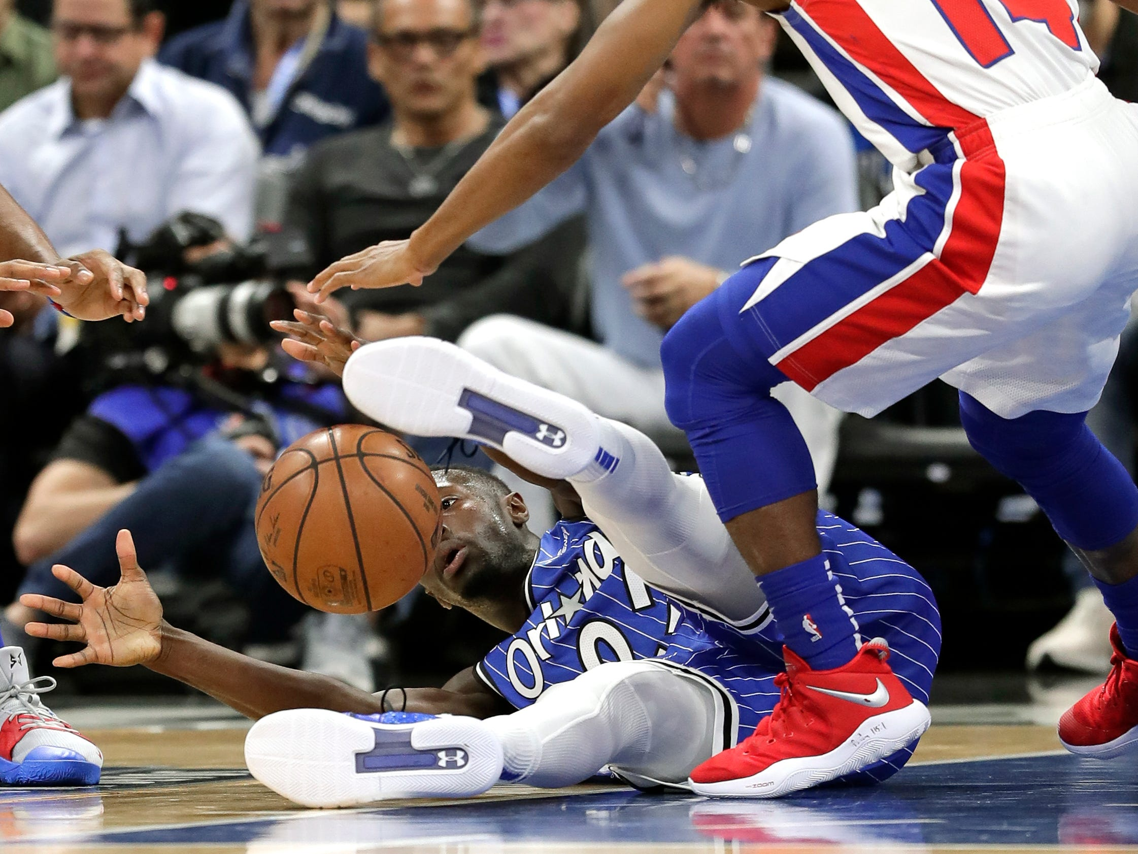 Orlando Magic's Jerian Grant, lower left, goes after a loose ball against Detroit Pistons' Ish Smith (14) during the first half of an NBA basketball game, Wednesday, Nov. 7, 2018, in Orlando, Fla.