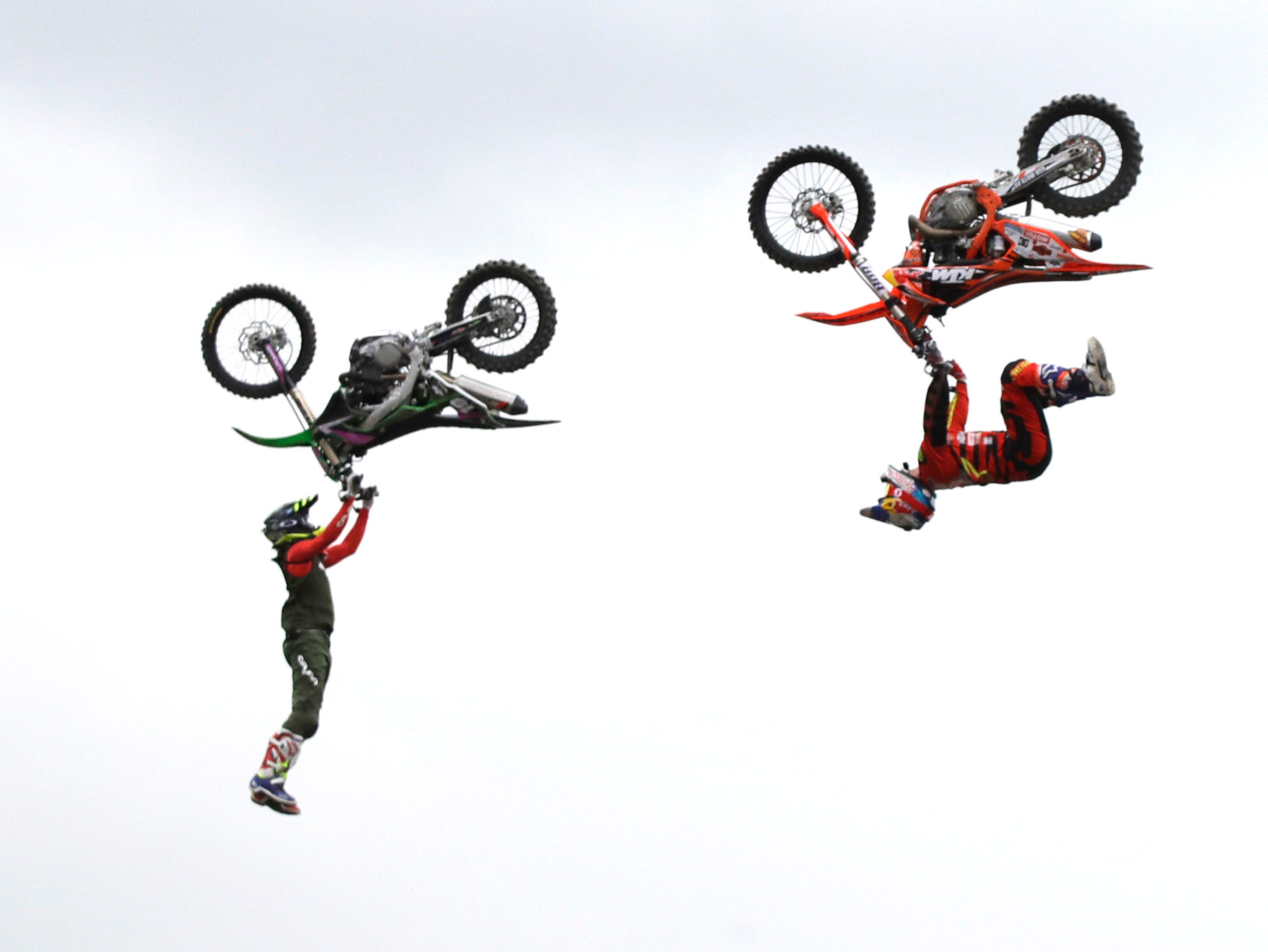 Riders perform during a freestyle motocross show at the EICMA exhibition motorcycle fair in Milan, Italy, Thursday, Nov. 8, 2018.