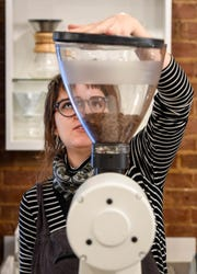 Amanda McDaniel grinds a batch of coffee beans at the River City Coffee and Goods on Main Street in Evansville Thursday, November 8, 2018.