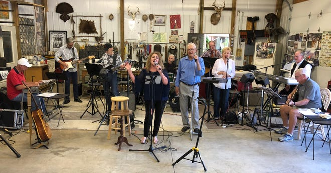 "Singer Kathy Barnes Hillcock, center, belts out the Grammy award-winning song ""Girl Crush,"" backed by her brother, Larry Barnes (beside her) and the rest of a band that has been rehearsing for months in a large shop behind Larry's home on U.S. 41-South in Henderson. They will present a show, Larry & Kathy Barnes and Friends, on Nov. 24 at the Preston Arts Center at Henderson Community College."