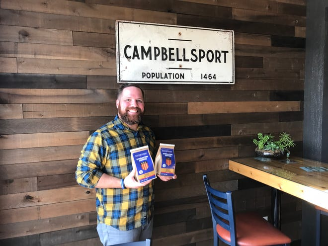 Marine Corps Veteran Sam Floyd small-batch roasts coffee for his business, Operation Coffee, which seeks to start a conversation about topics like veteran suicide. Floyd is pictured in Blue Door Coffee Co., which sells the coffee.