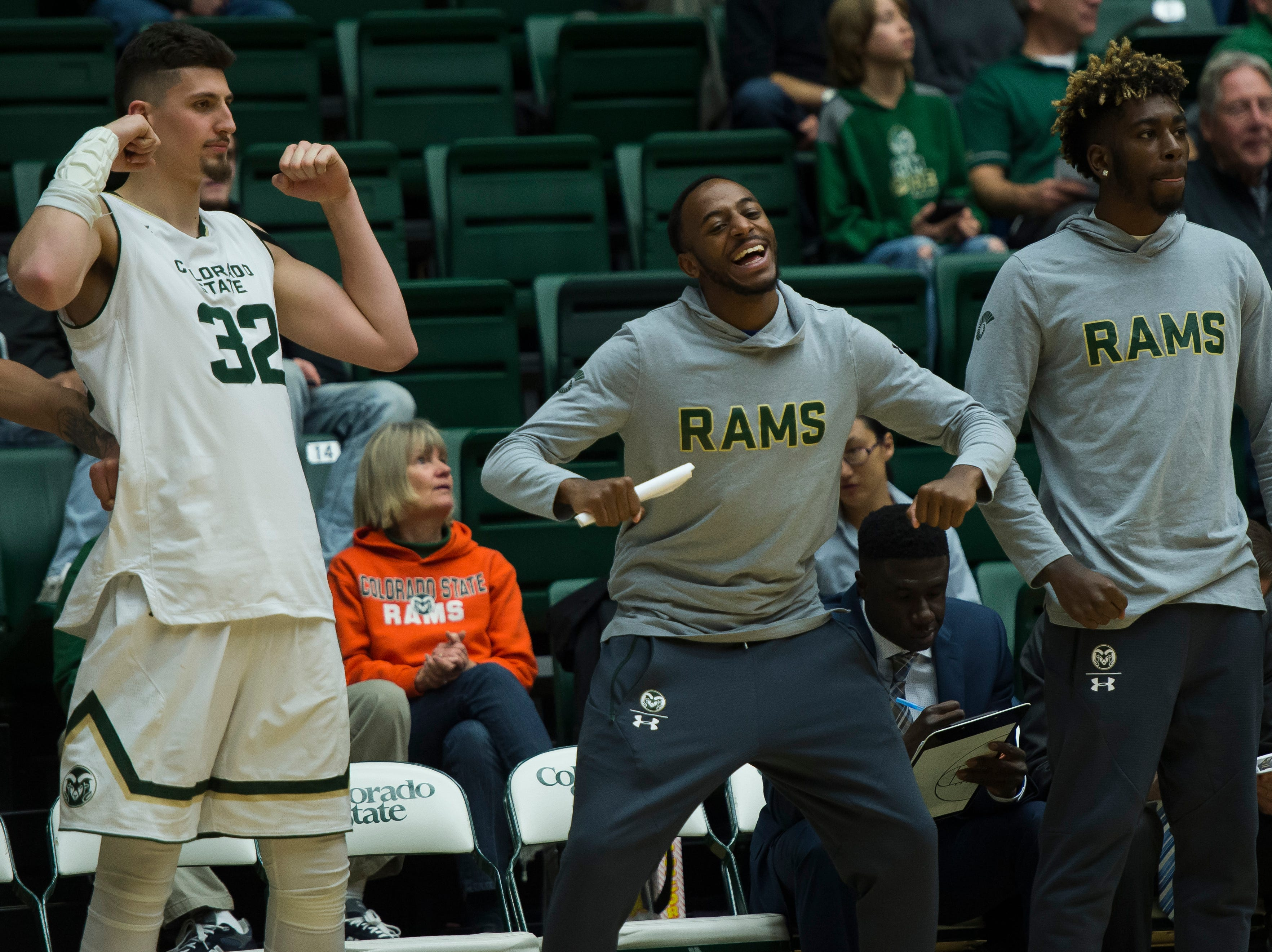 Colorado State University seniors Nico Carvacho (32), J.D. Paige (22) and junior Kris Martin (30) react from the bench during a game against Colorado Christian University on Wednesday, Nov. 7, 2018, at Moby Arena in Fort Collins, Colo.