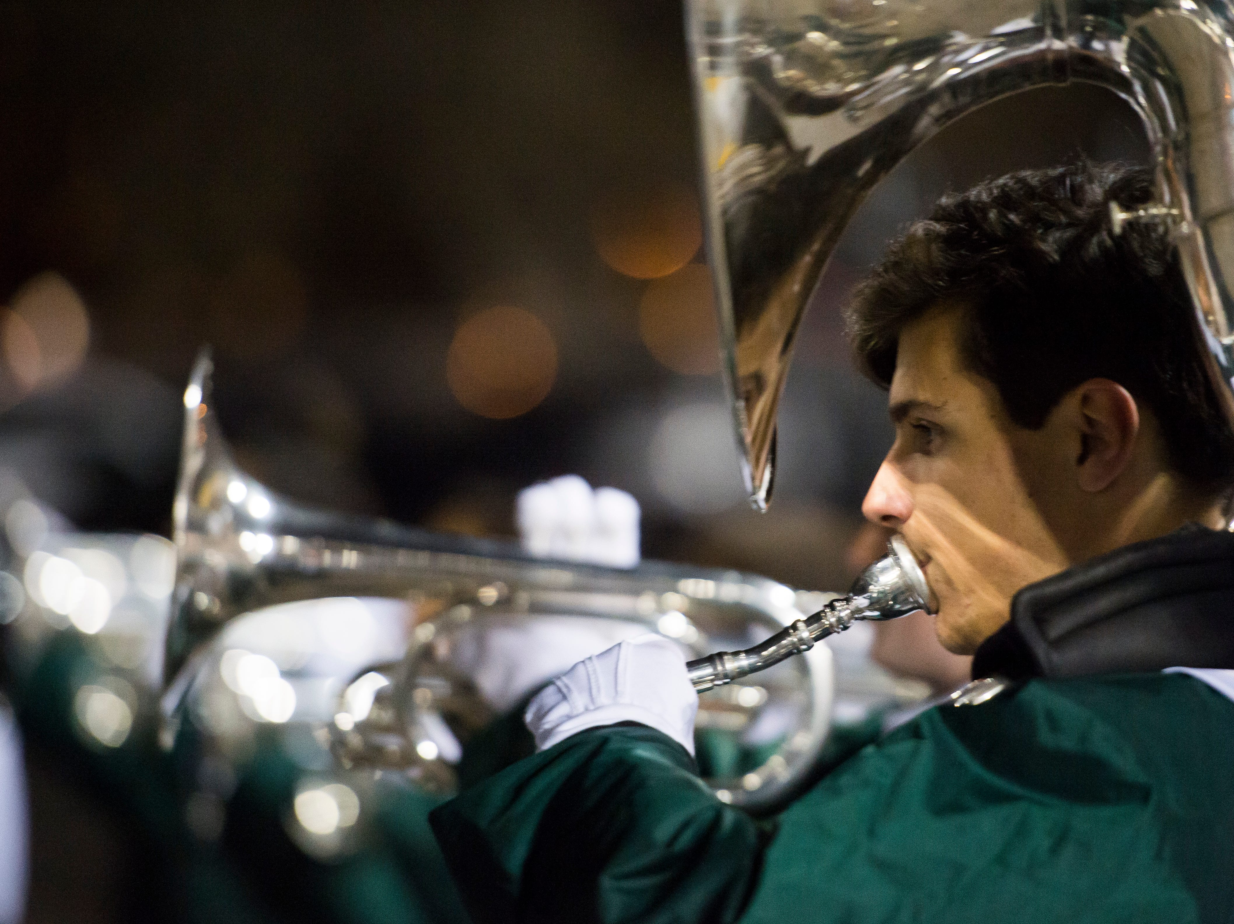 "The Fossil Ridge High School marching band performs an encore performance of their state-title-winning ""Enlightenment"" on Wednesday, Nov. 7, 2018, at French Field in Fort Collins, Colo."