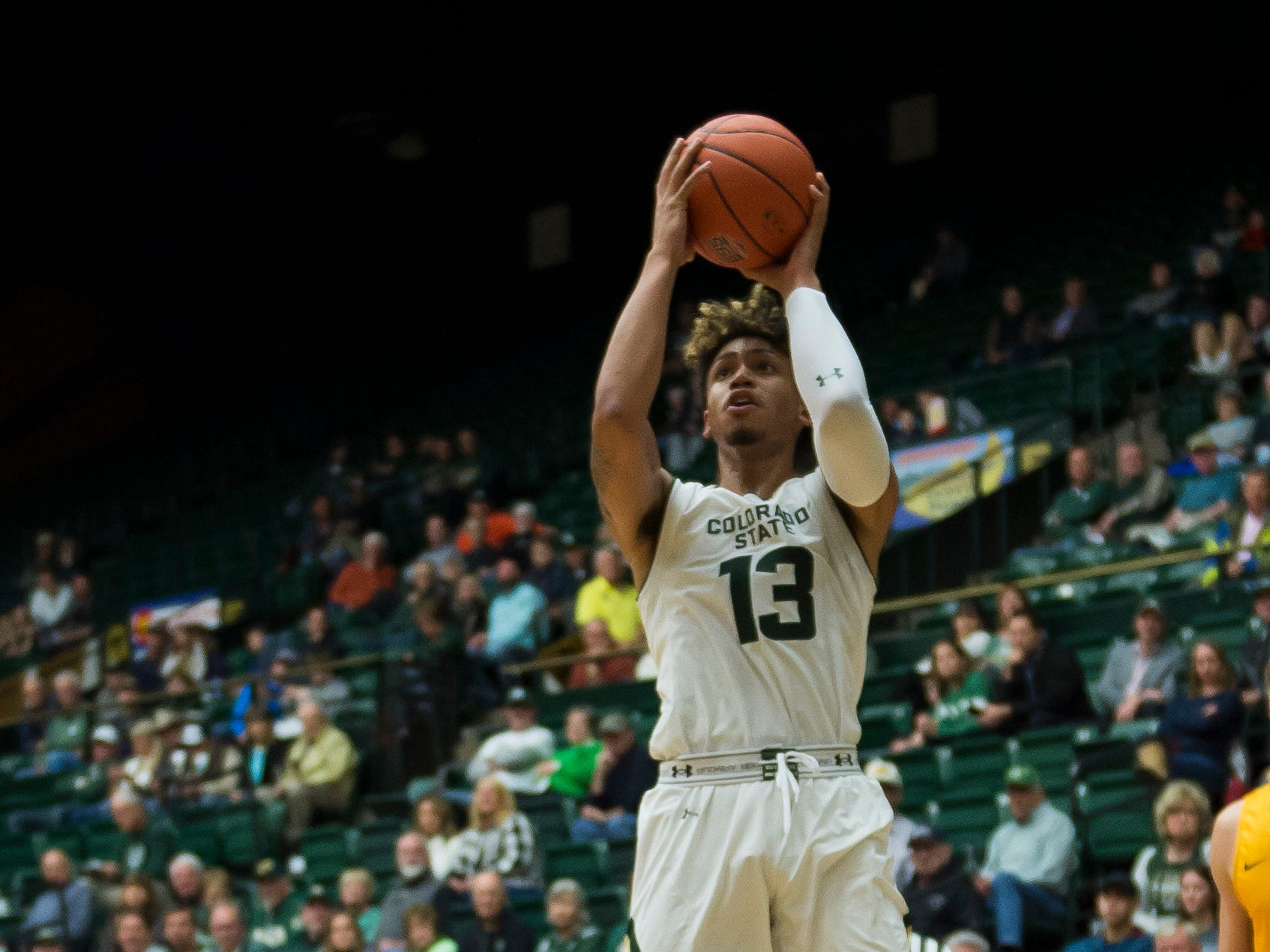 Colorado State University junior forward Lorenzo Jenkins (13) takes a shot over Colorado Christian University junior guard Terry McFadden (1) on Wednesday, Nov. 7, 2018, at Moby Arena in Fort Collins, Colo.