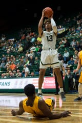CSU basketball player Lorenzo Jenkins, shown shooting over a Colorado Christian defender during a Nov. 7, 2018, game at Moby Arena, is transferring to Grand Canyon University for his final season, he said Wednesday on Twitter.