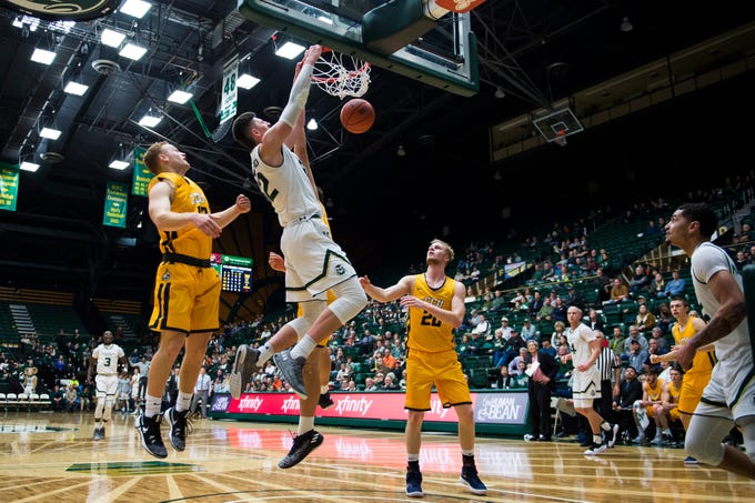 Colorado State University junior center Nico Carvacho (32) dunks just before the half in a game against Colorado Christian University on Wednesday, Nov. 7, 2018, at Moby Arena in Fort Collins, Colo.