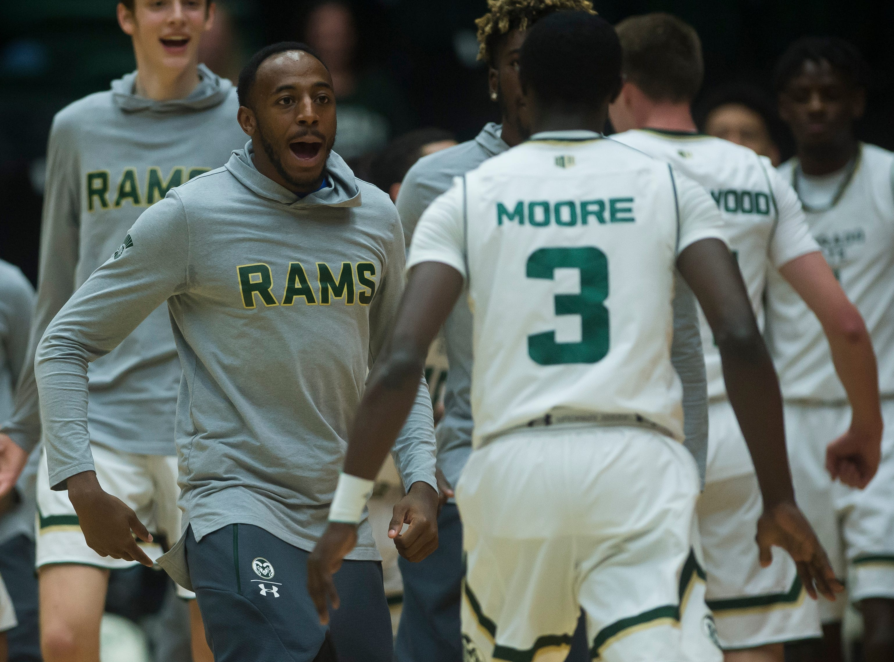 Colorado State University senior guard J.D. Paige greets freshman guard Kendle Moore (3) during a timeout in a game against Colorado Christian University on Wednesday, Nov. 7, 2018, at Moby Arena in Fort Collins, Colo.