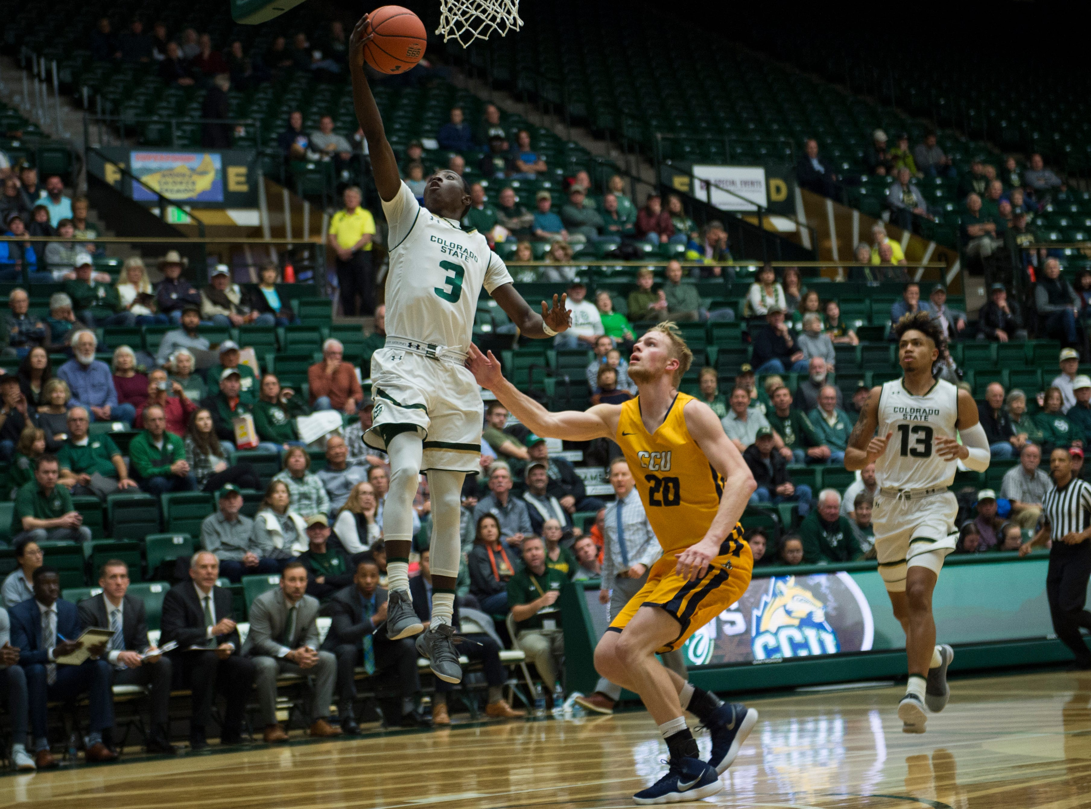 Colorado State University freshman guard Kendle Moore (3) puts a shot up past Colorado Christian University sophomore guard Justin Engesser (20) on Wednesday, Nov. 7, 2018, at Moby Arena in Fort Collins, Colo.