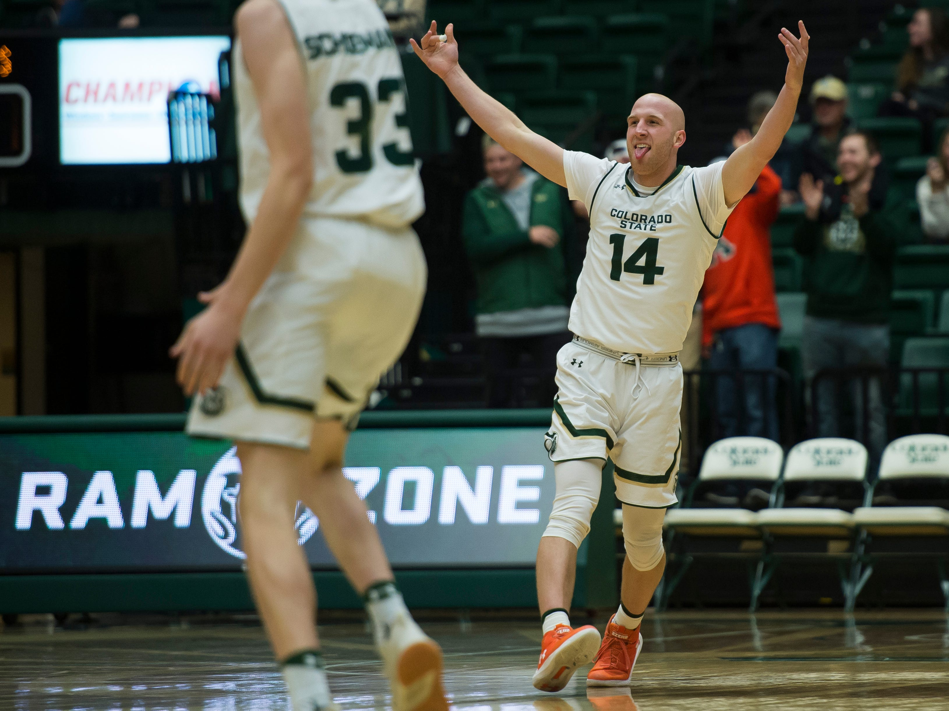 Colorado State University senior guard Robbie Berwick (14) reacts after throwing a no-look pass that resulted in a three-pointer during a game against Colorado Christian University on Wednesday, Nov. 7, 2018, at Moby Arena in Fort Collins, Colo.