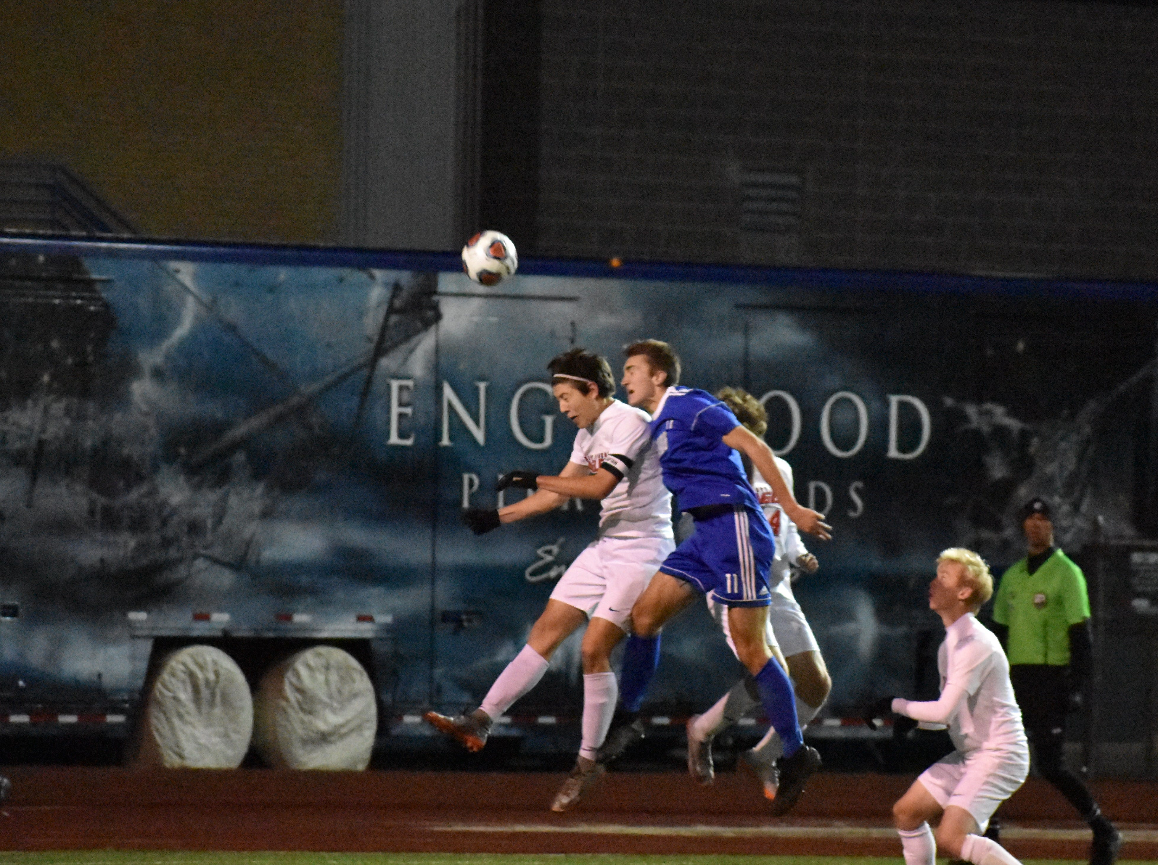 Liberty Common's Elliot McCormick heads the ball during the Eagles' state semifinal win over Roaring Fork.