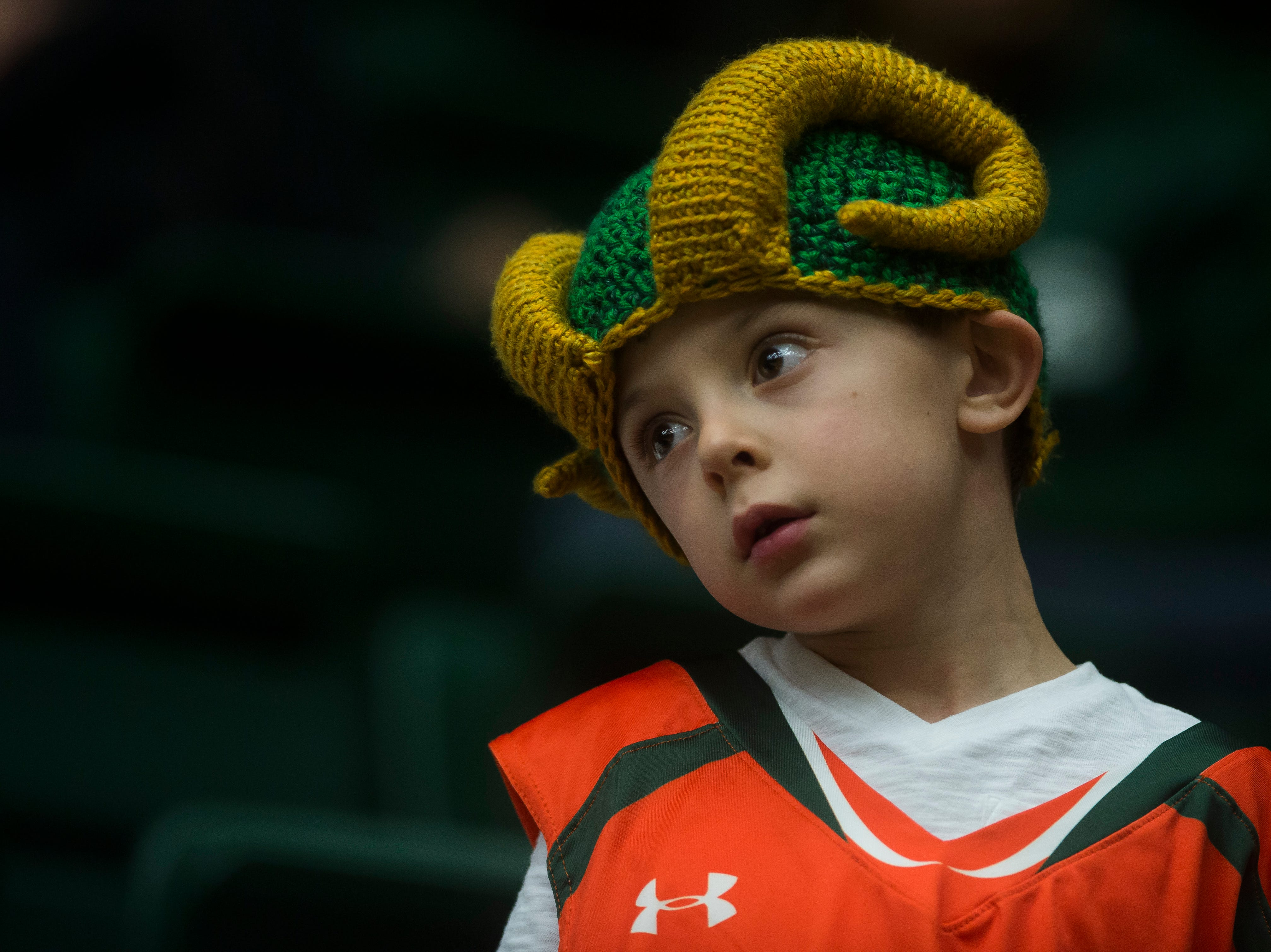 A young Colorado State University fan looks on during a game against Colorado Christian University on Wednesday, Nov. 7, 2018, at Moby Arena in Fort Collins, Colo.