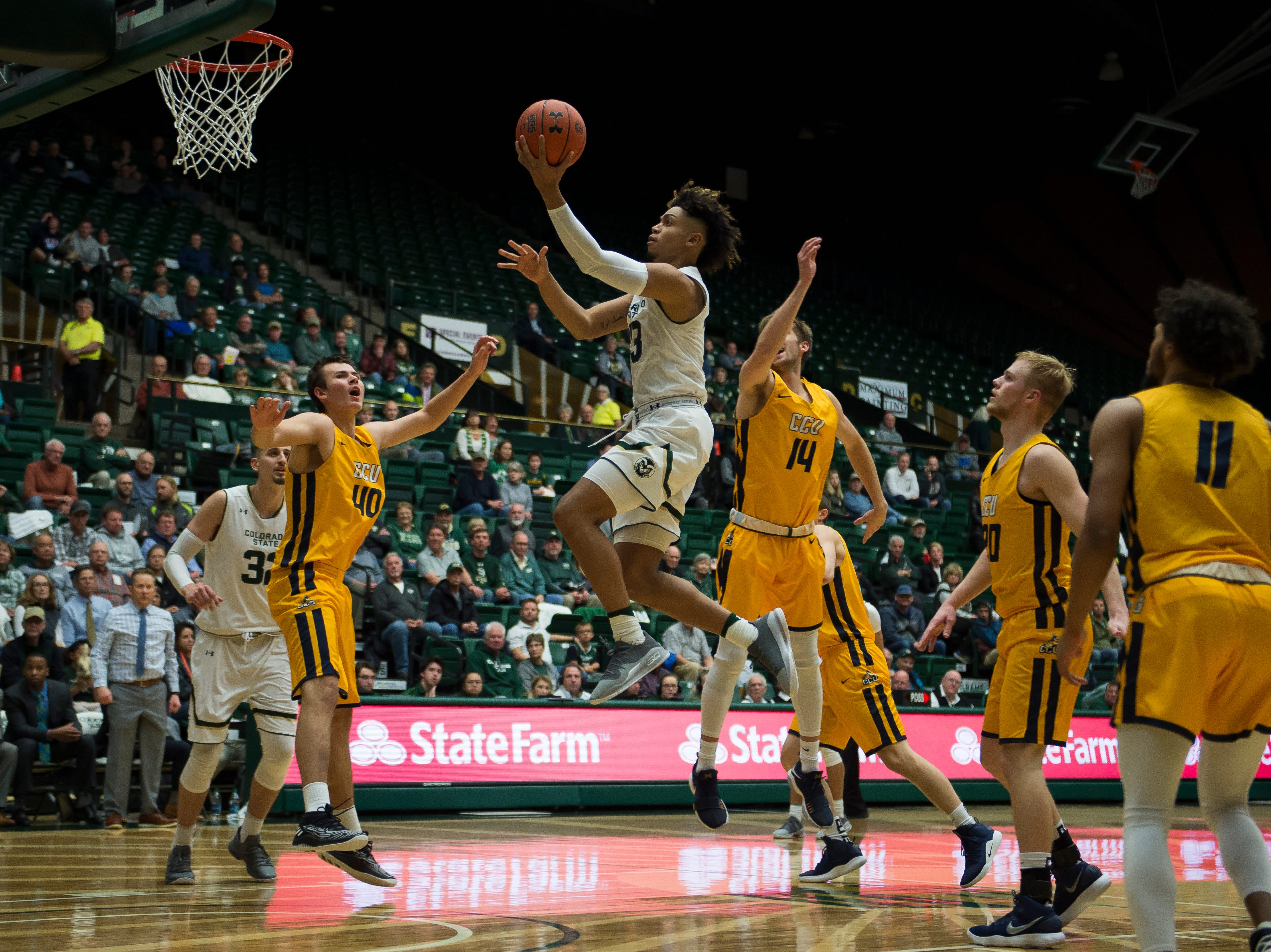 Colorado State University junior forward Lorenzo Jenkins (13) takes a shot over Colorado Christian University defenders on Wednesday, Nov. 7, 2018, at Moby Arena in Fort Collins, Colo.
