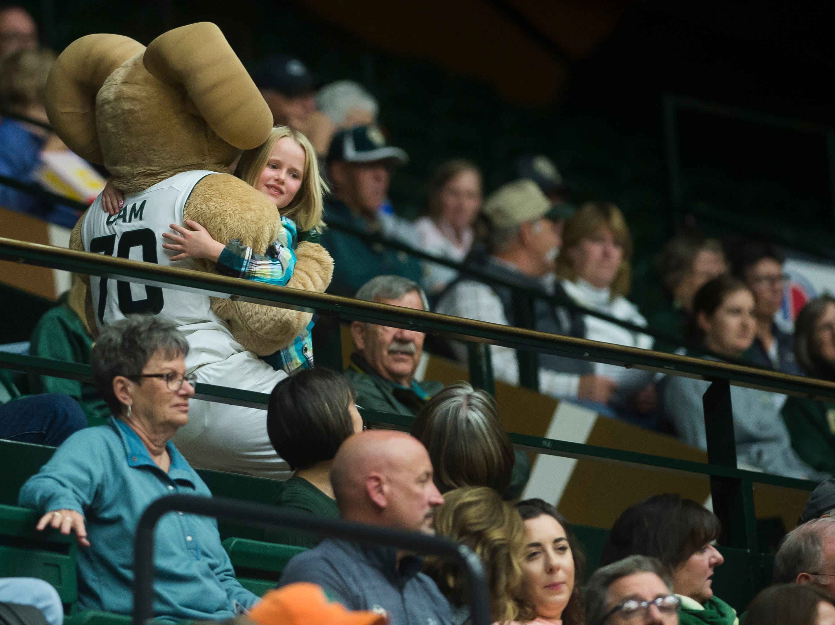 Colorado State University mascot Cam the Ram hugs a young fan during a game against Colorado Christian University on Wednesday, Nov. 7, 2018, at Moby Arena in Fort Collins, Colo.
