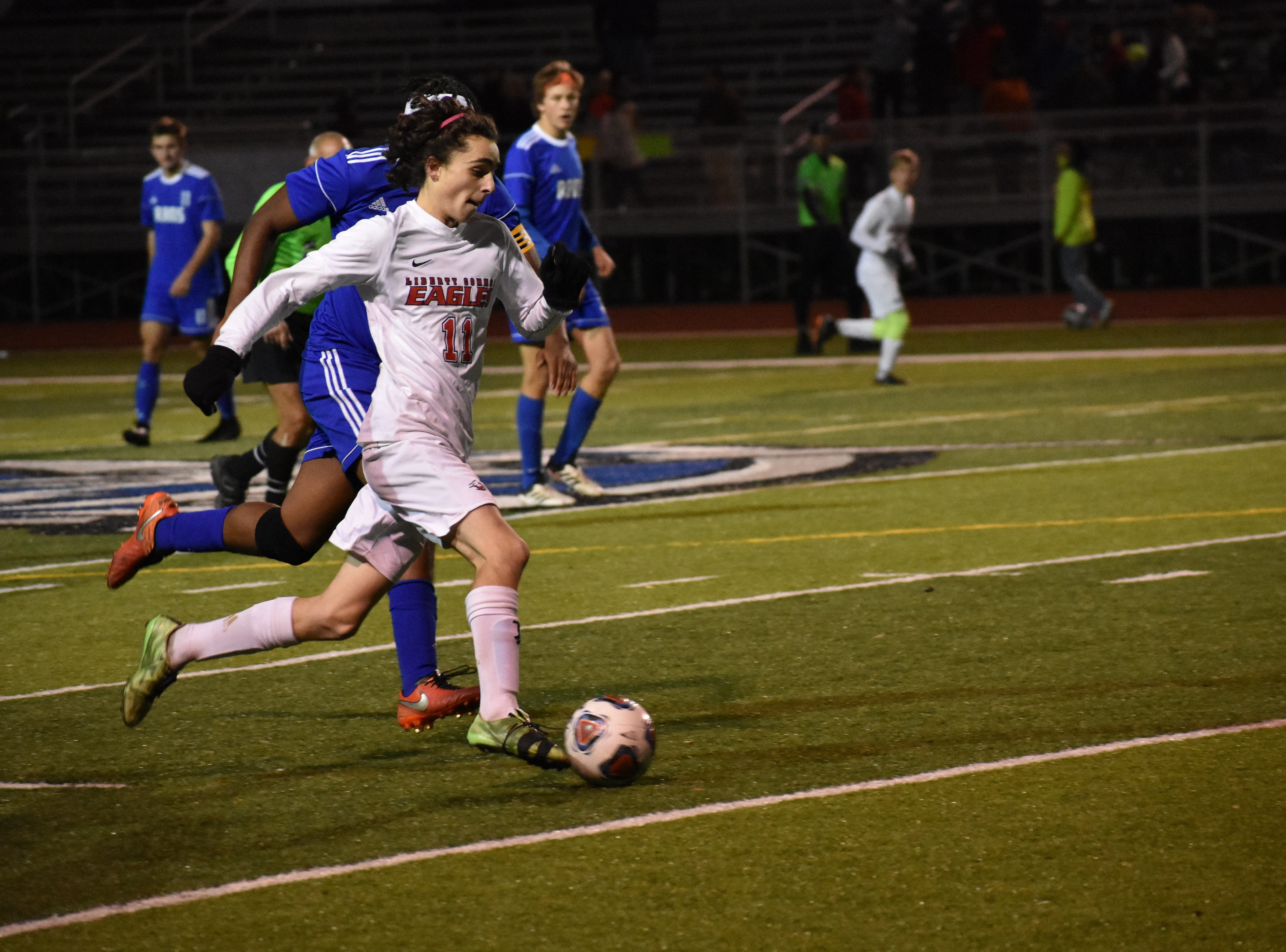 Liberty's Zach Harker dribbles past a defender during the Eagles' state semifinal win over Roaring Fork.