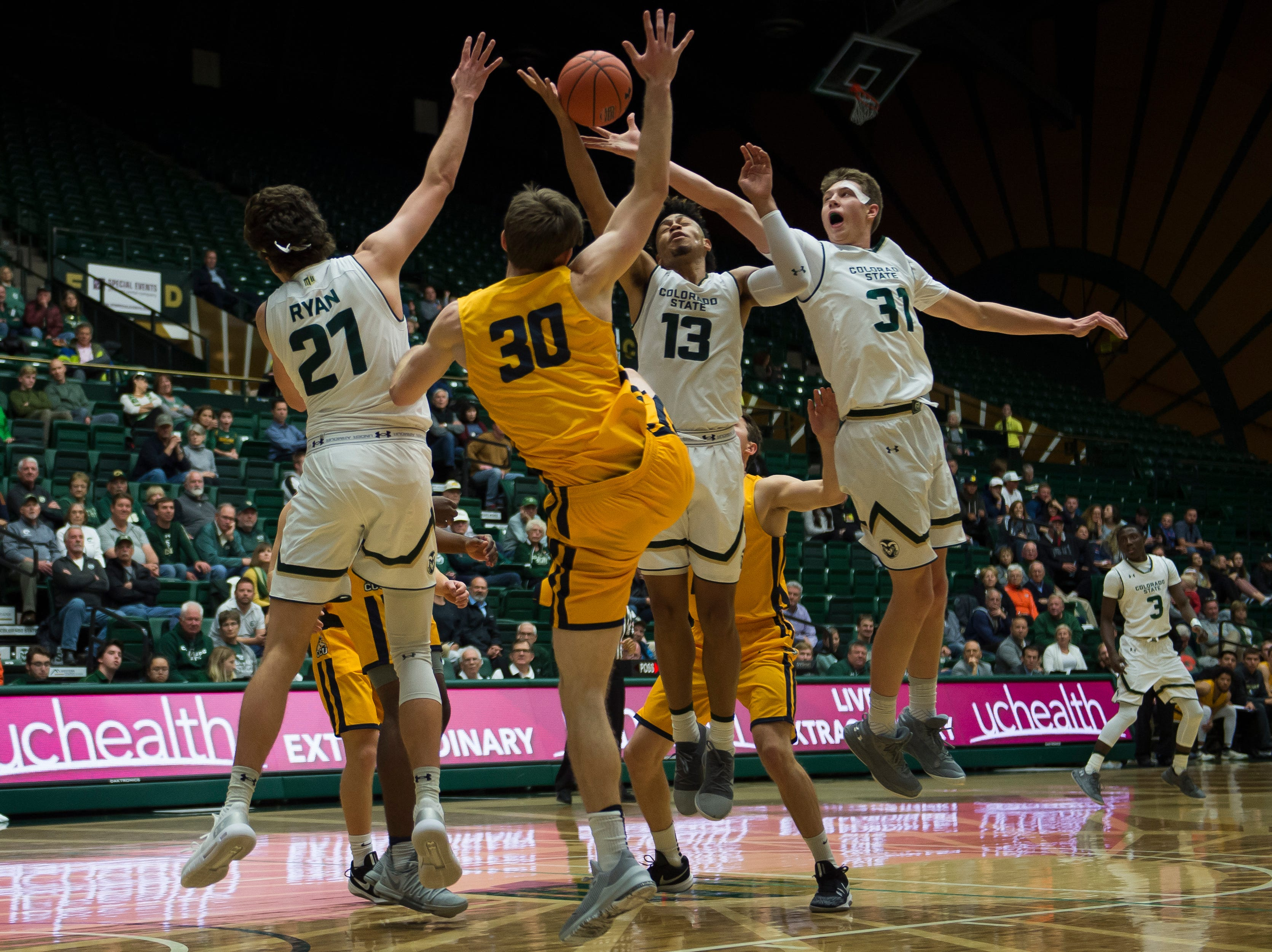 Colorado State University freshman forward Adam Thistlewood (31) goes up for a rebound during a game against Colorado Christian University on Wednesday, Nov. 7, 2018, at Moby Arena in Fort Collins, Colo.
