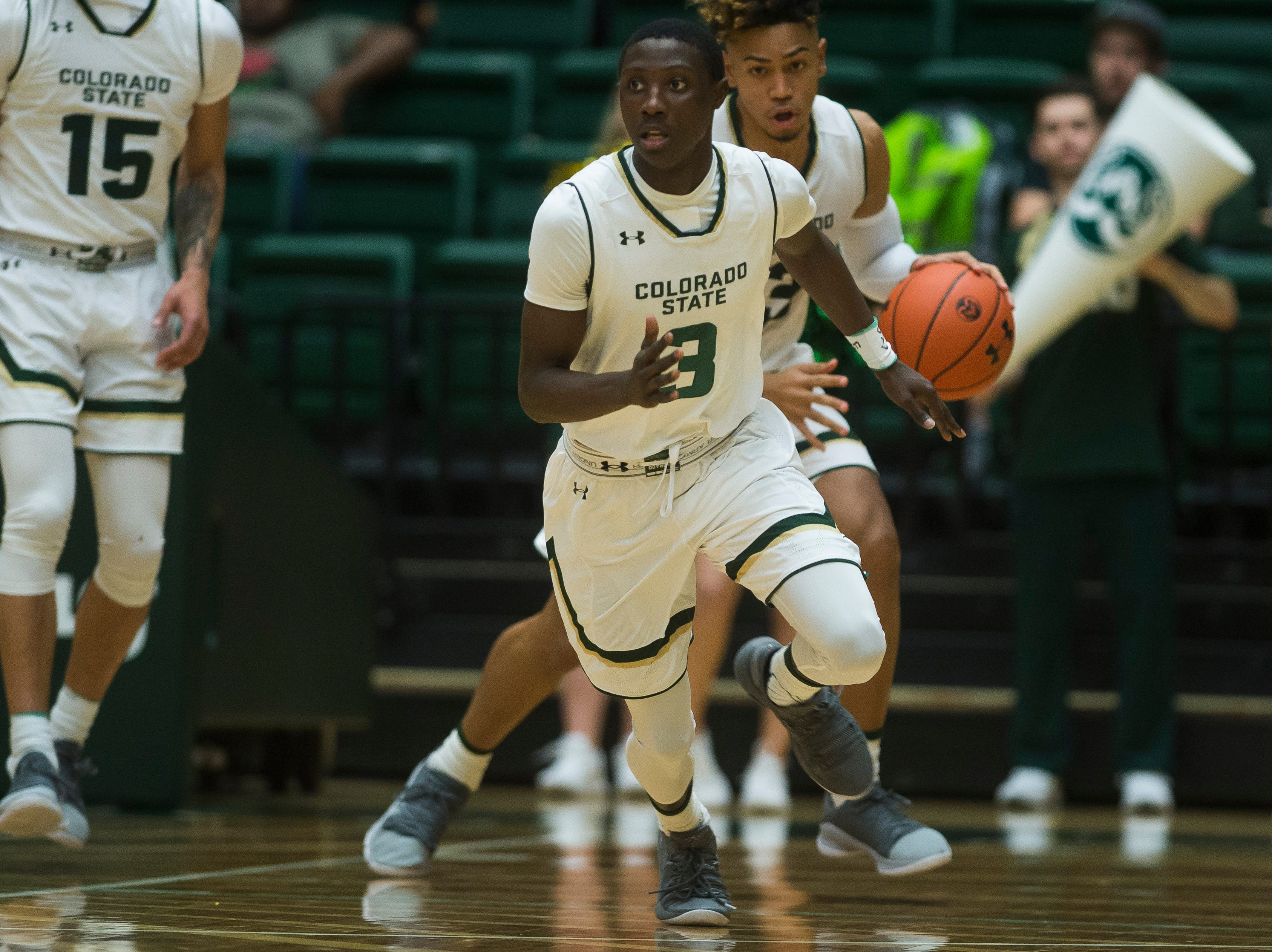 Colorado State University freshman guard Kendle Moore (3) takes the ball downcourt during a game against Colorado Christian University on Wednesday, Nov. 7, 2018, at Moby Arena in Fort Collins, Colo.