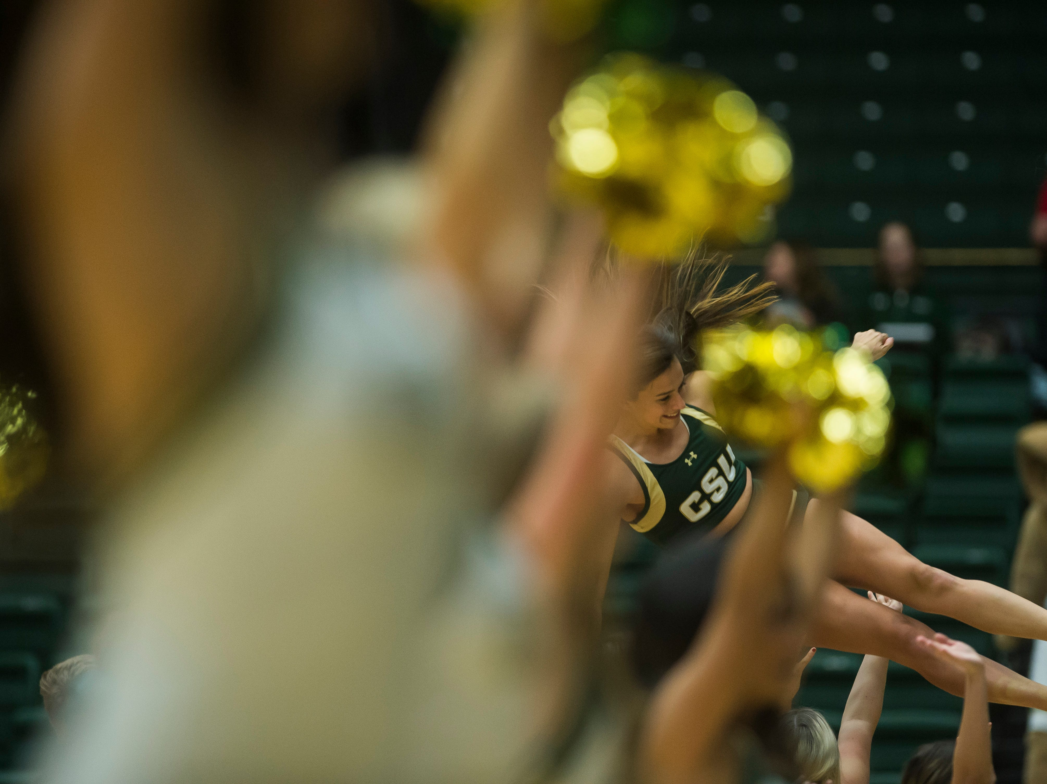 Colorado State University cheerleaders perform during a timeout in a game against Colorado Christian University on Wednesday, Nov. 7, 2018, at Moby Arena in Fort Collins, Colo.