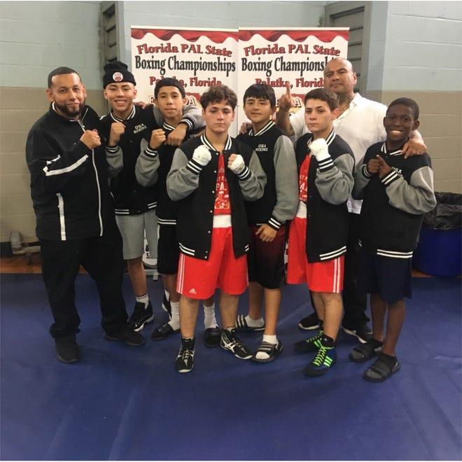 FMPD PAL Boxing Team: Head coach Jose Ojeda, Danilo Diez, Terry Sanders, Nate Martinez, Josiah Bravo Vasquez, Jayden Pozo, Jeremy Pozo, assistant coach Rudy Martinez, Kejuan Saez.