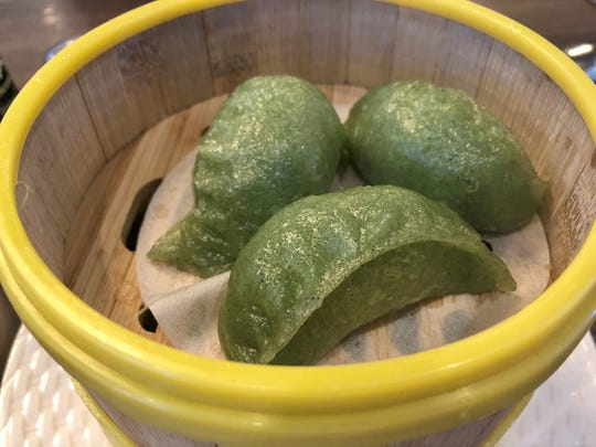 Shrimp spinach dumplings ($4.50) are filled with tender minced shrimp in a delicate skin dyed green with spinach.
