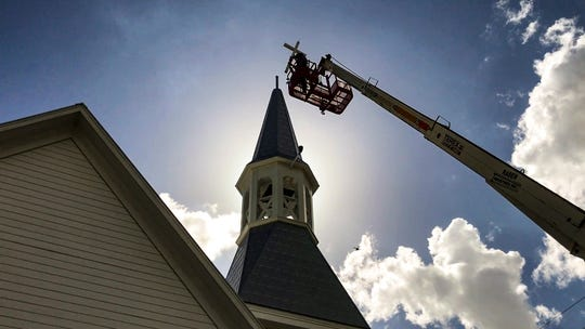 Matt Gay with Campbellsville Industries, Inc. and Jim Blythe, Chairman of the board for Alva Methodist Church, install the cross. The final step. Alva Methodist church got a new steeple after Irma toppled its last one. They are thankful for all the donations that helped cover the cost of the deductible so they could replace it. This one has been built and installed with hurricane standards.