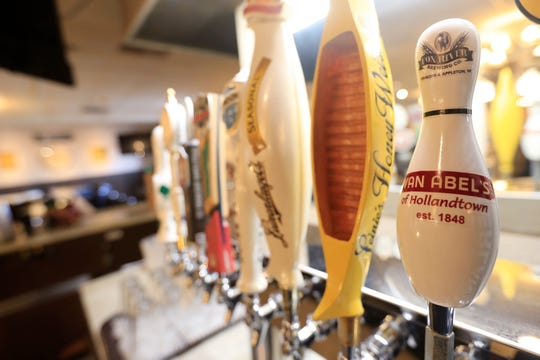 A tap handle for Van Abel's beer is shown at the bar at Van Abel's supper club on Thursday, October 25, 2018 in Hollandtown, Wis.