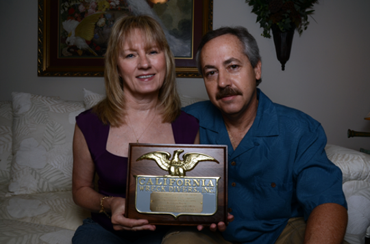 Joe Porter and his wive, Heidi, hold the California Wreck Divers Hall of Fame Award they won.