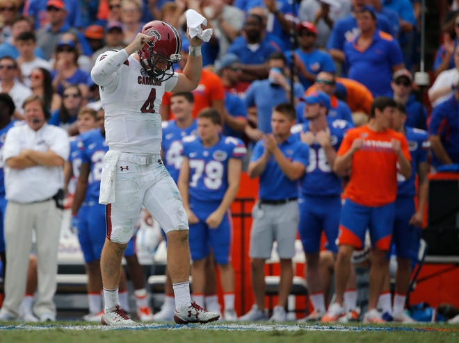 In this Nov. 12, 2016 photo, South Carolina quarterback Jake Bentley (4) looks down as he reacts against Florida during the second half at Ben Hill Griffin Stadium. Florida Gators defeated the South Carolina Gamecocks 20-7.
