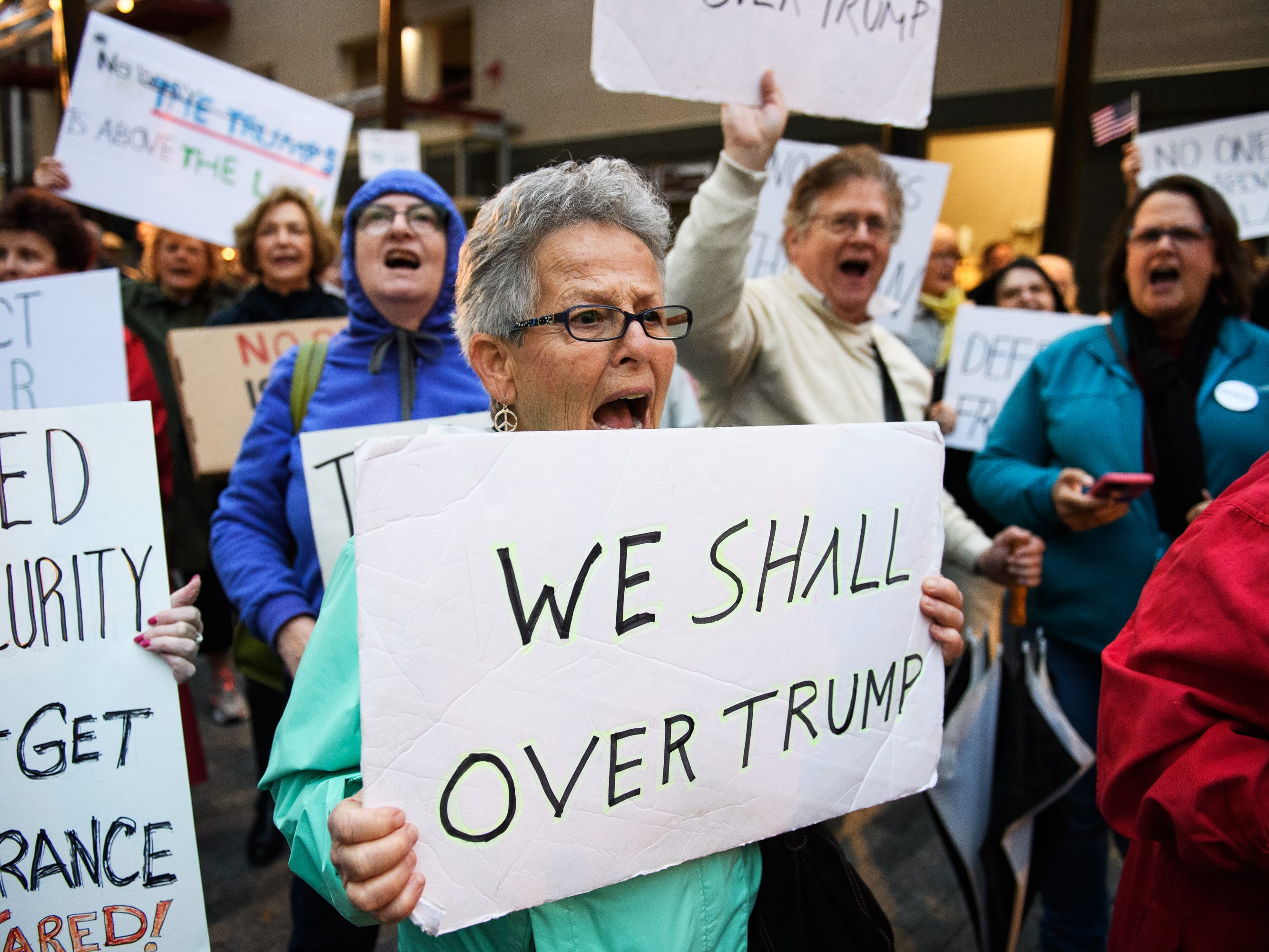 Dianne Perry participates in a protest over fears that President Donald Trump is derailing the Mueller investigation at One City Plaza in downtown Greenville on Thursday, Nov 8, 2018.