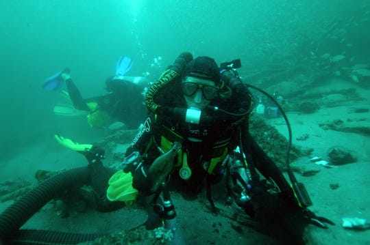 A diver excavates a shipwreck in this photo from Wreck Diving Magazine.