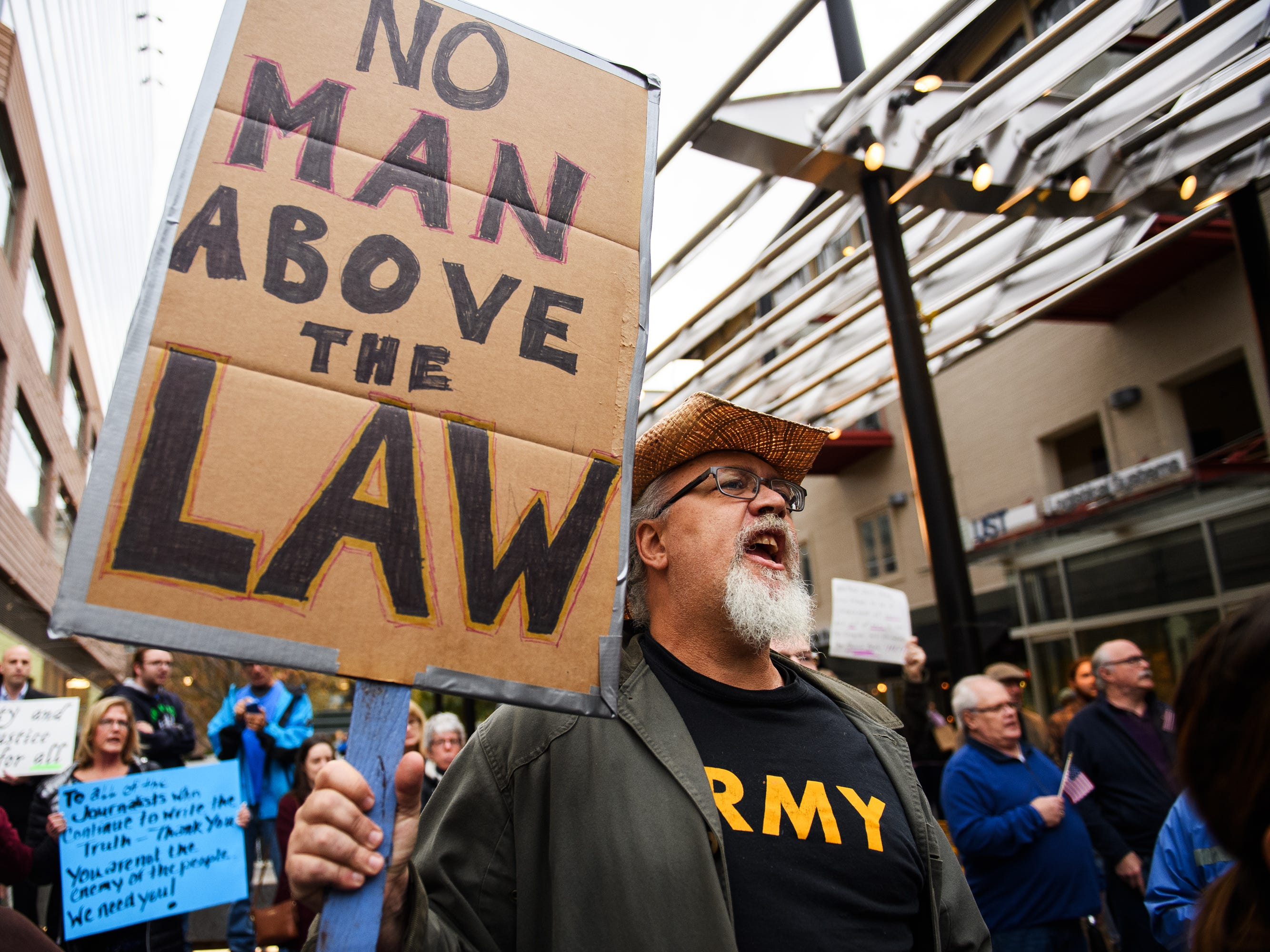 Dan Conover participates in a protest over fears that President Donald Trump is derailing the Mueller investigation at One City Plaza in downtown Greenville on Thursday, Nov 8, 2018.